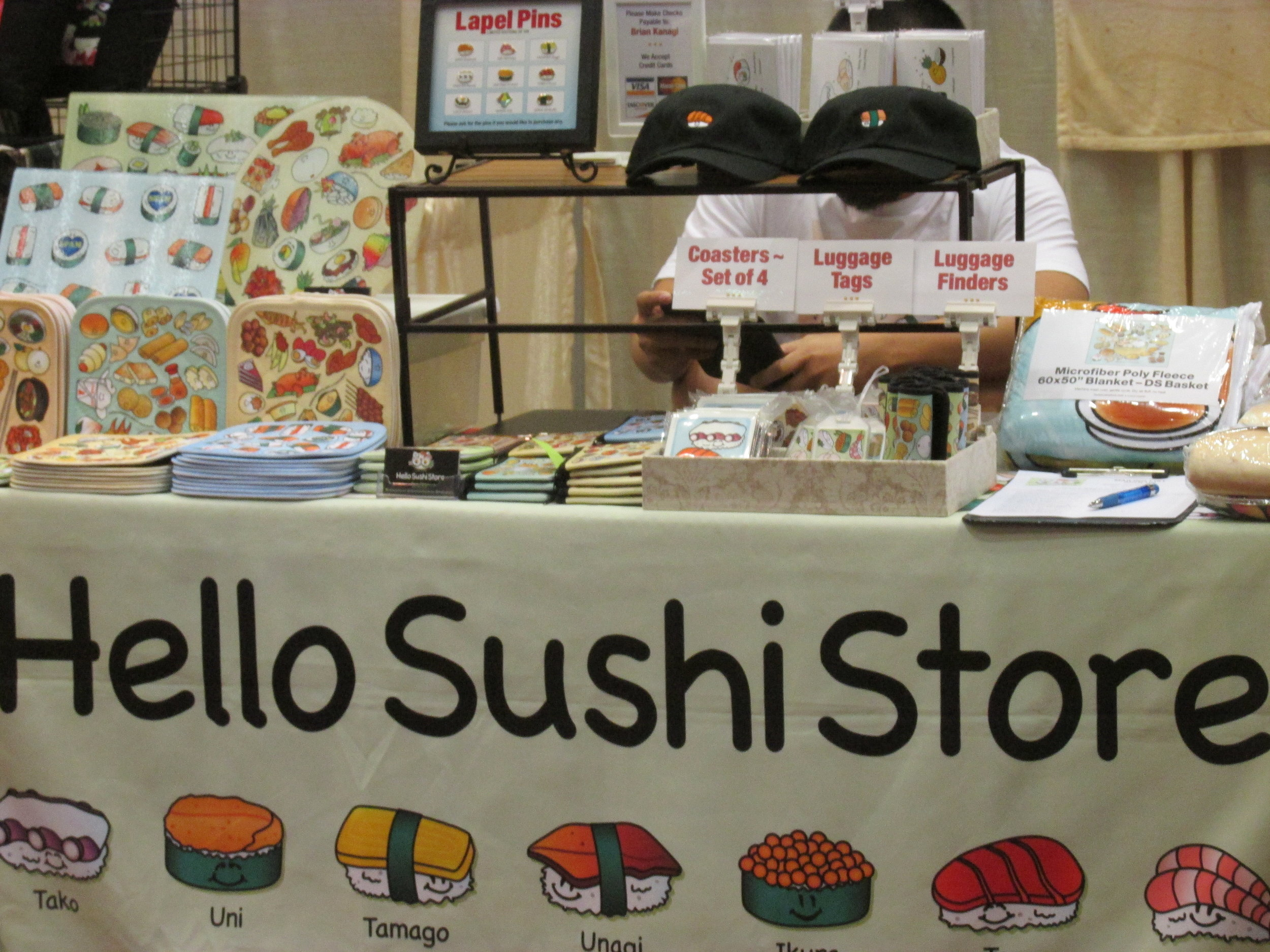 The booth in front of us was Hello Sushi Store.