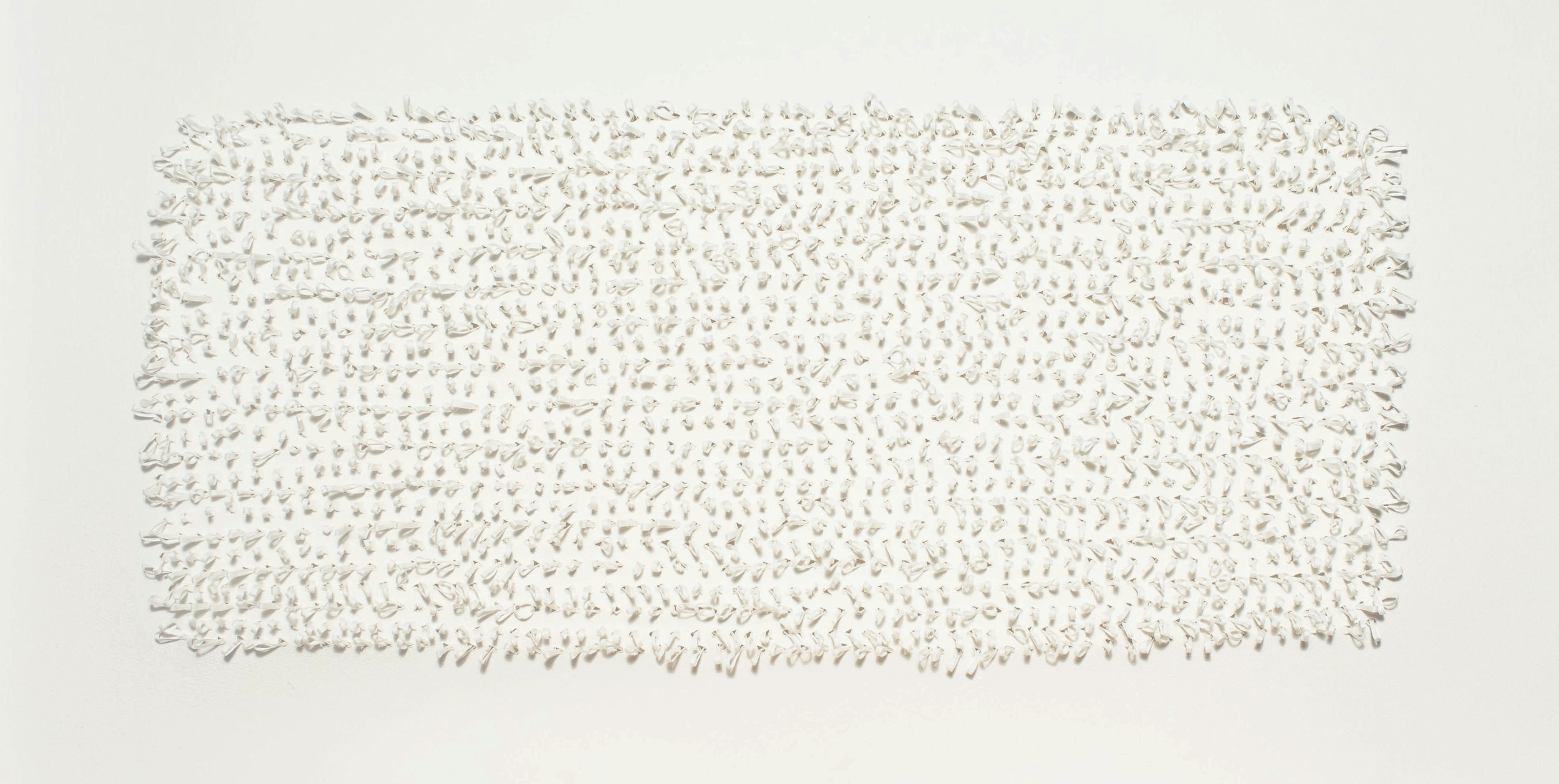 Tufting is a technique traditionally used through open weave fabric for rug making. These 3 dimensional wall pieces are created using the same tufting form through cotton paper.  yarn : cotton gima