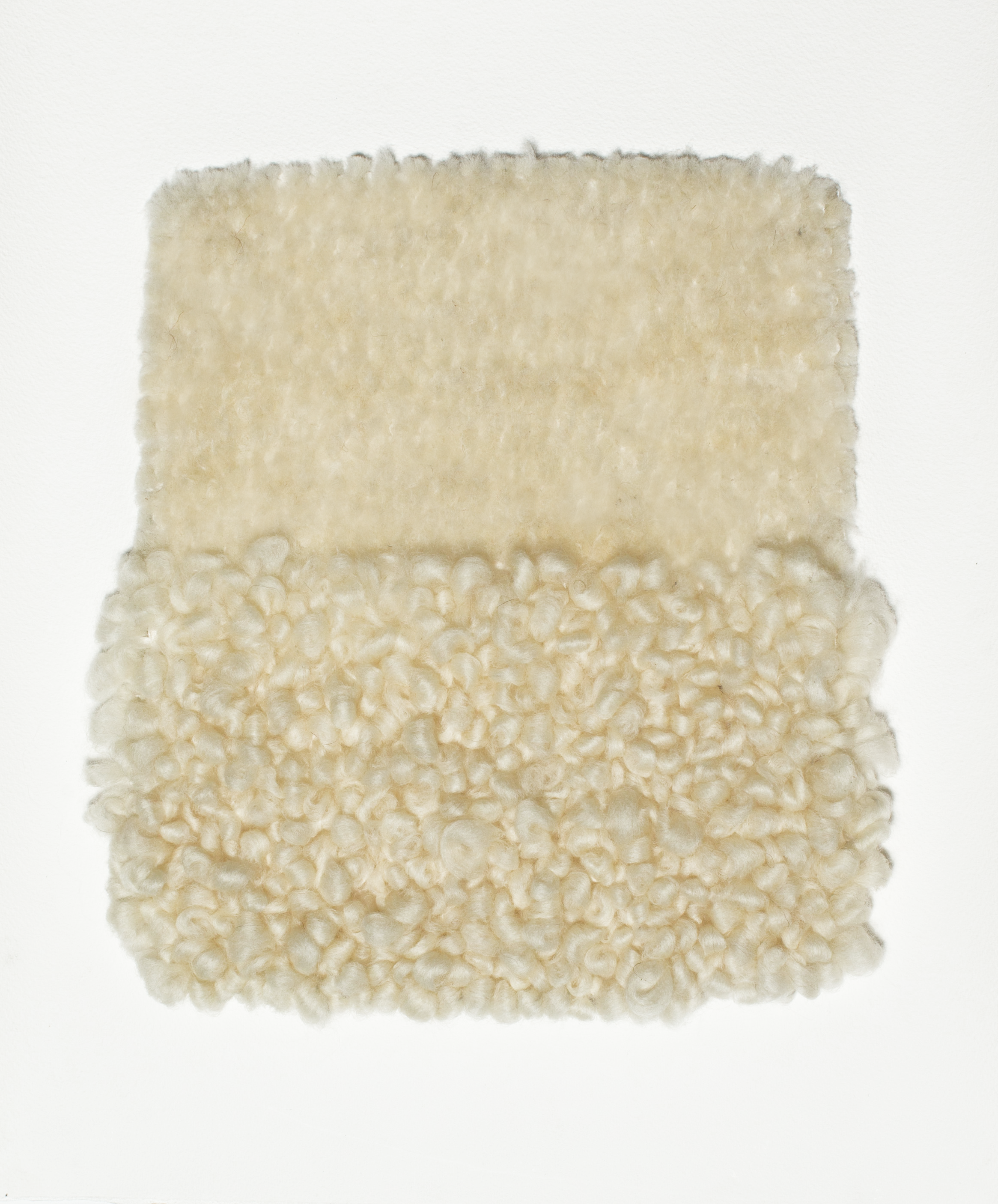 Tufting is a technique traditionally used through open weave fabric for rug making. These 3 dimensional wall pieces are created using the same tufting form through cotton paper.  yarn : wool roving