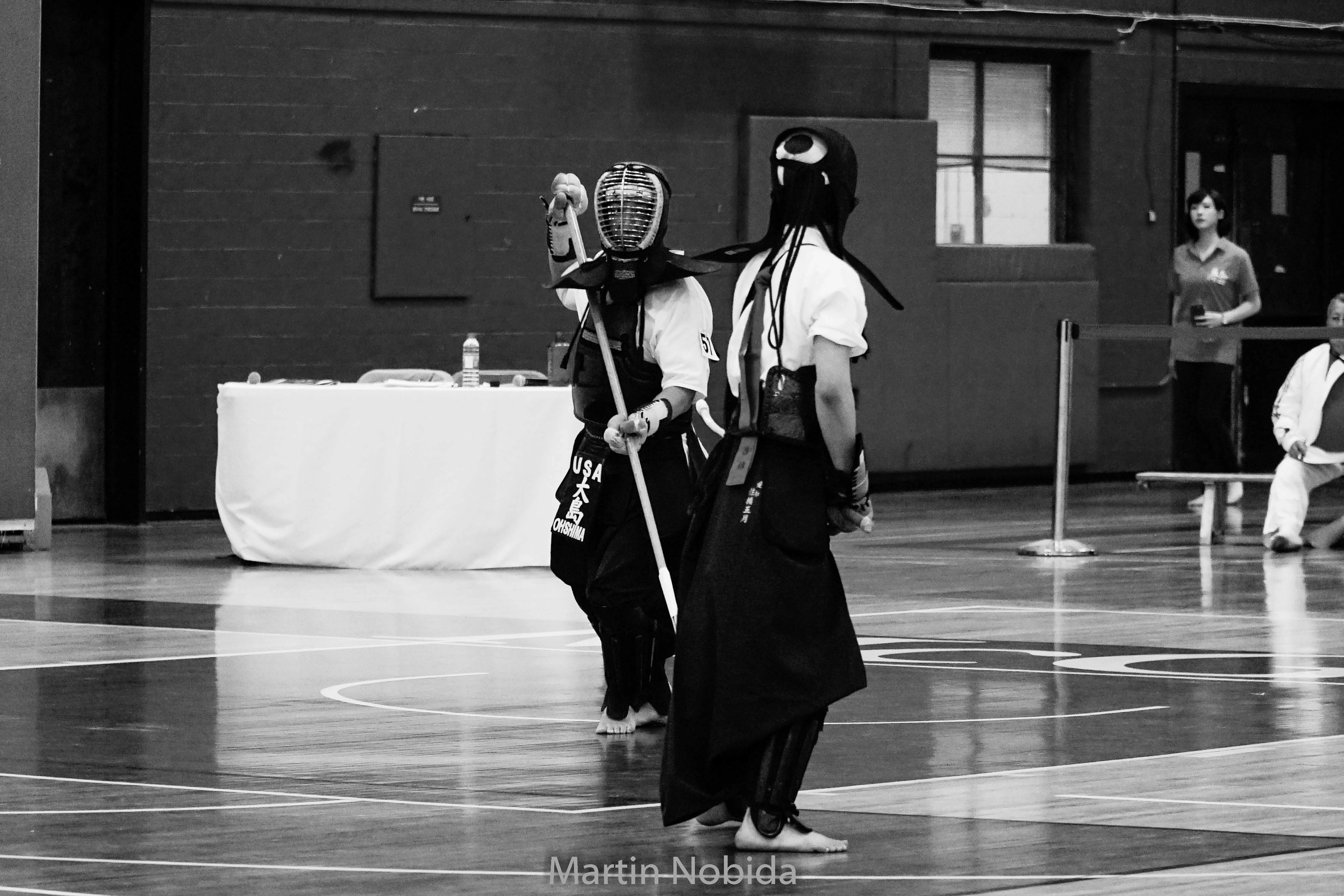 Saiyou Ohshima matches with a Japanese competitor at the 2015 International Naginata Federation World Cham