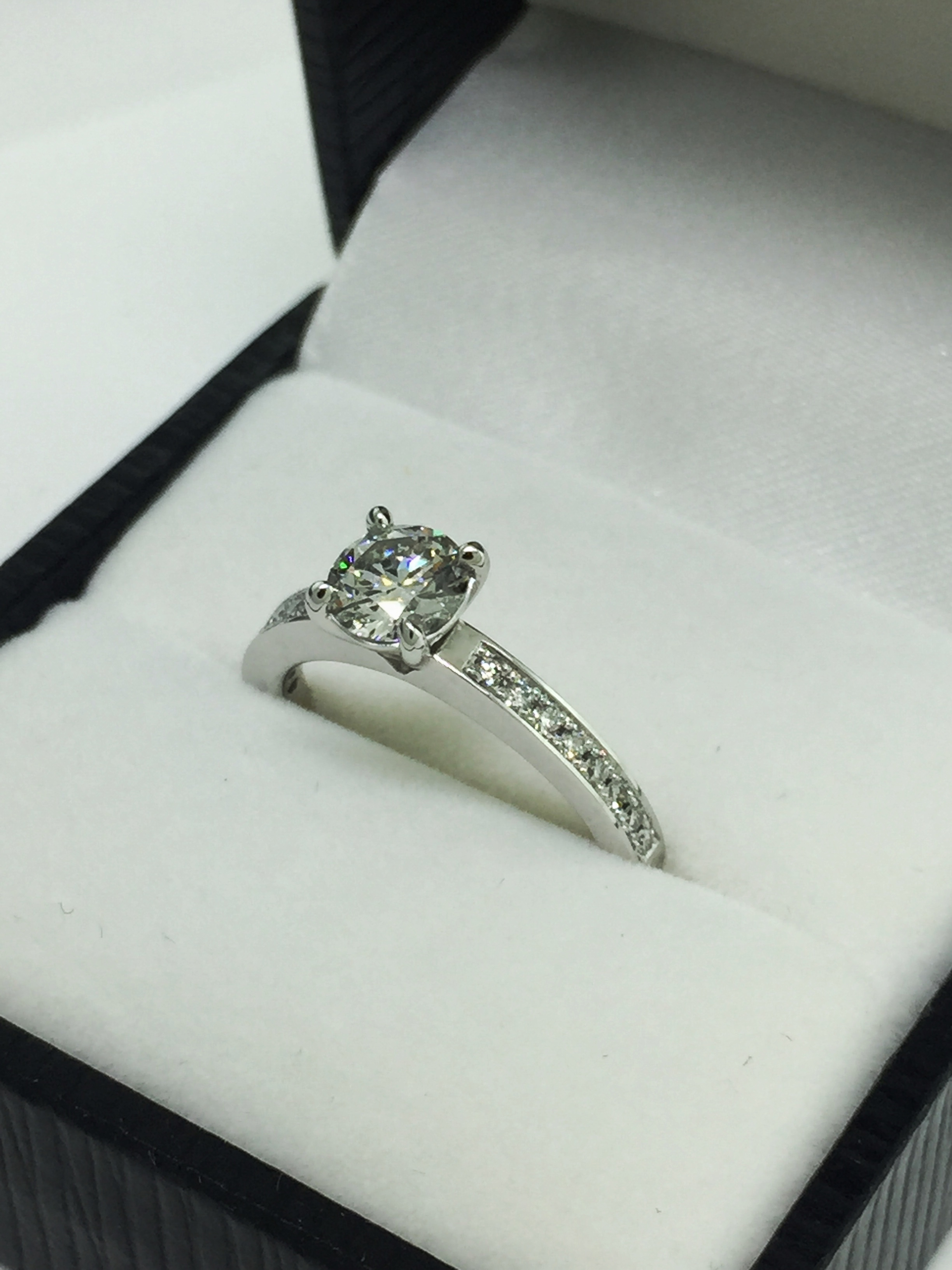 The finish piece, 18 carat white gold and platinum engagement ring with 1.00ct brilliant cut diamond.