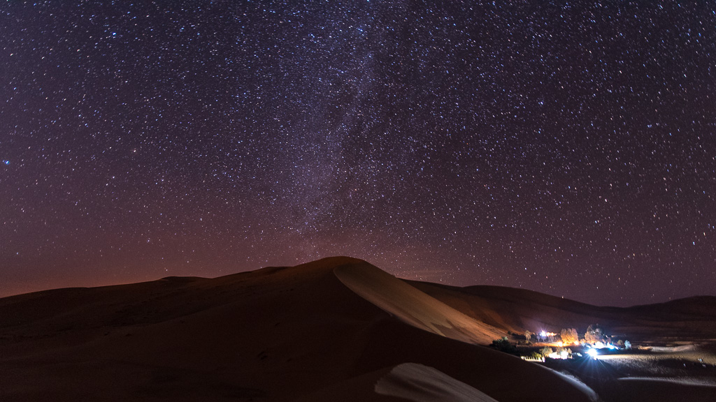 The Milky Way rises above a large dune in the Sahara, outside of Merzouga, Morocco.