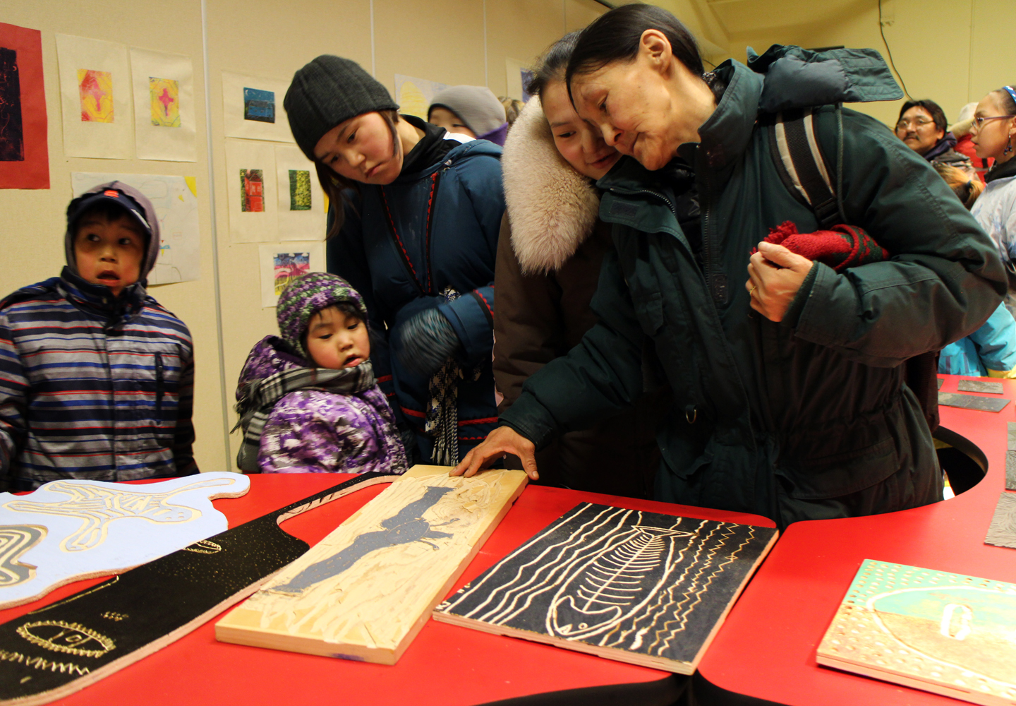 The Nuna family admires their youngest, Saaki's woodblock