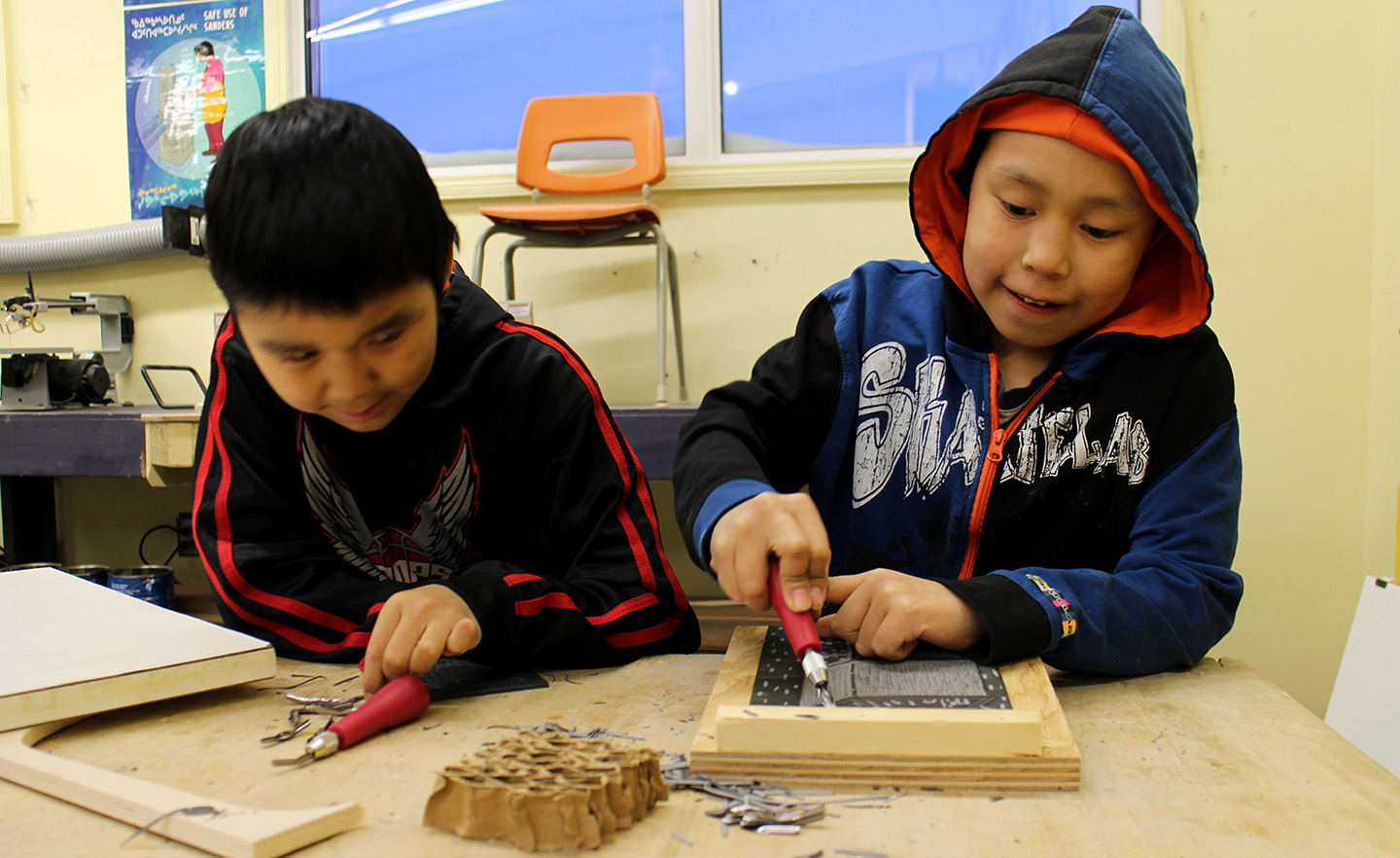 Saaki and Tommy carving lino blocks