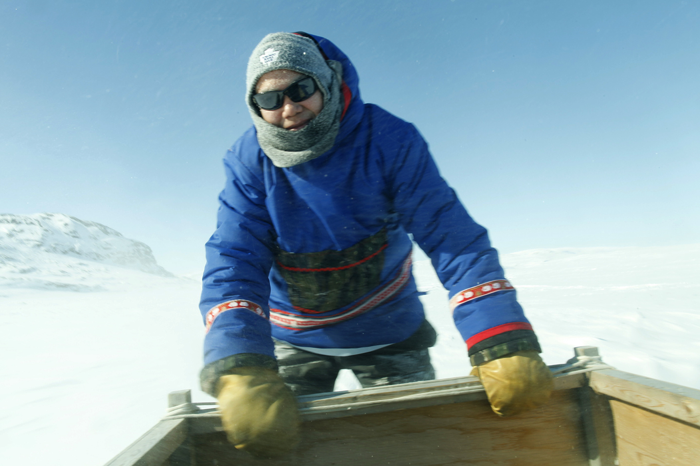 Parr surfing on the qamutik (sled)
