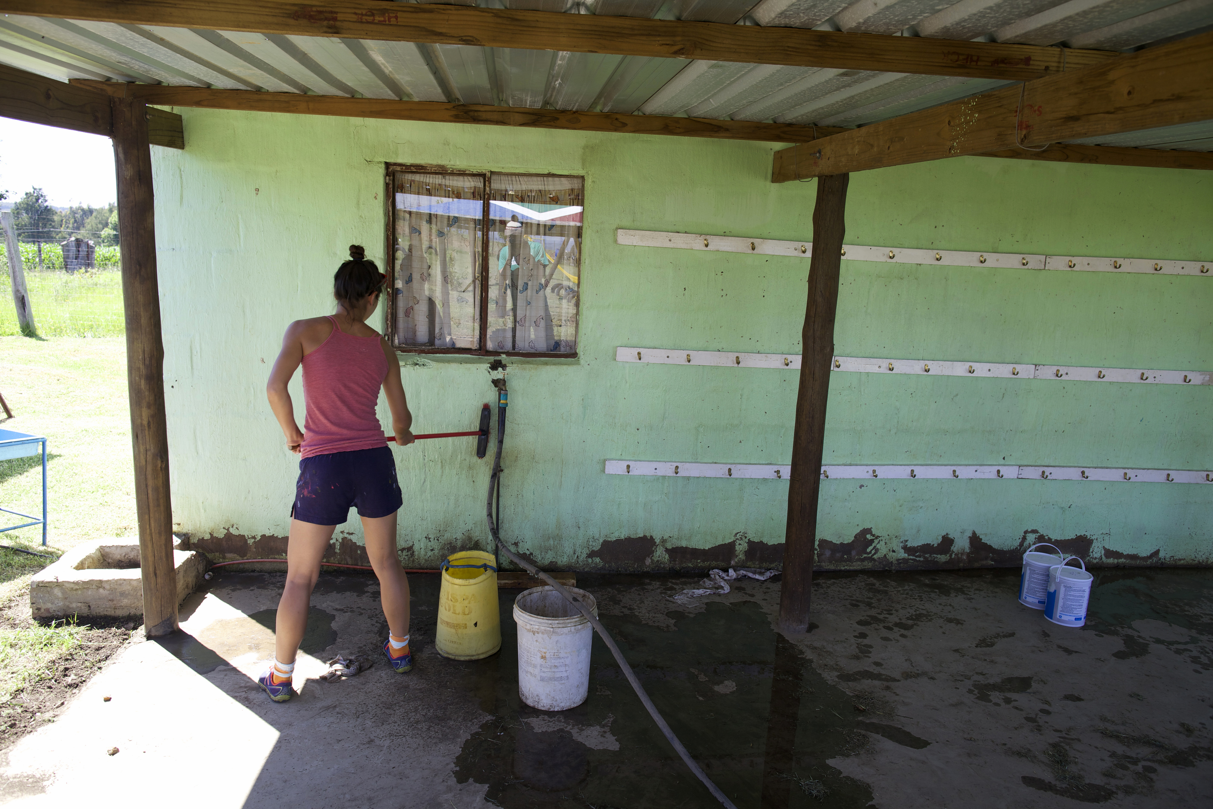 BEFORE: using elbow grease to prepare the wall for paint