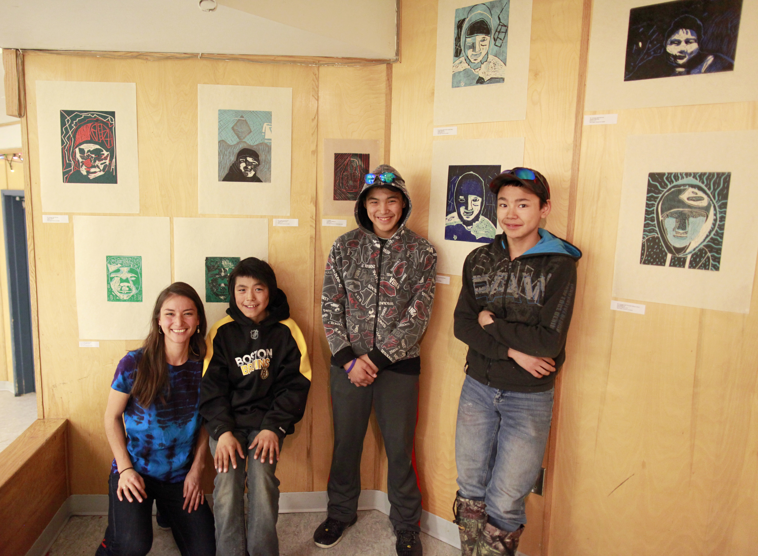 """Alexa, Johnny, Harry, Latch. Harry is standing beside his two-layer linocut self-Portrait """"Uvanga"""" that came 3rd across Canada for the Aboriginal Arts and Stories Contest!"""