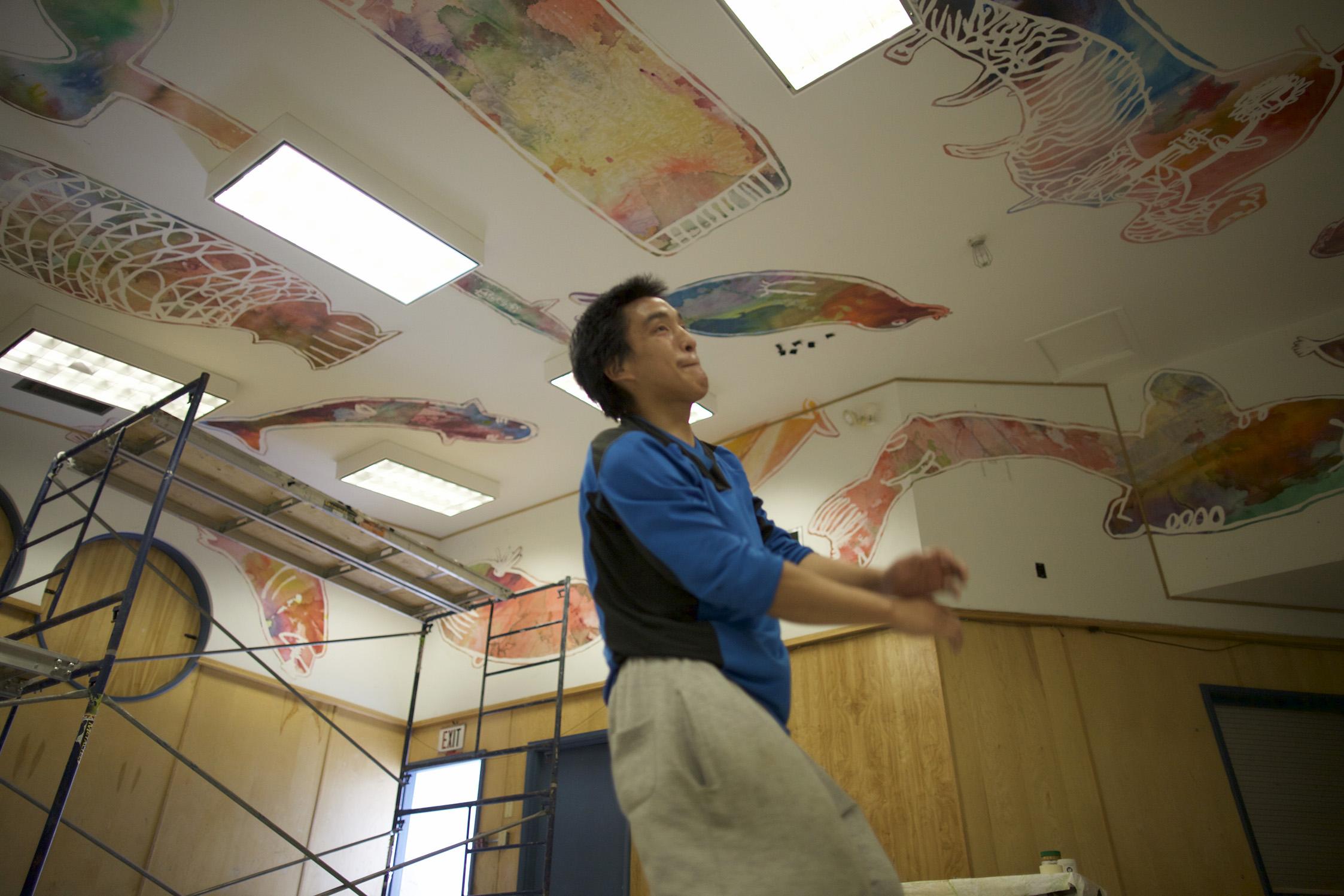Installing the mural makes Iqaluk break into dance!