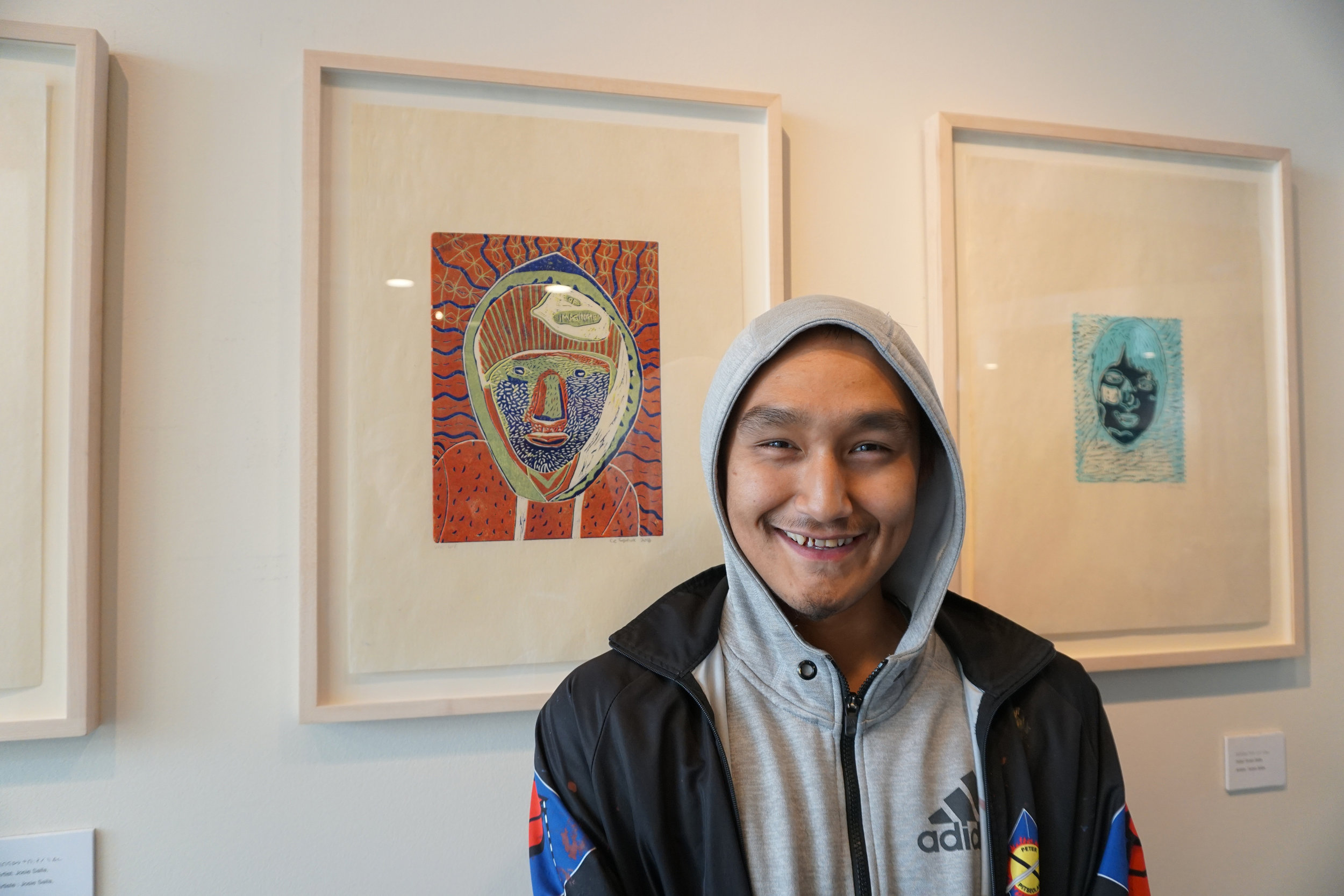 Cie Taqiasuk with his reductive linocut self-portrait