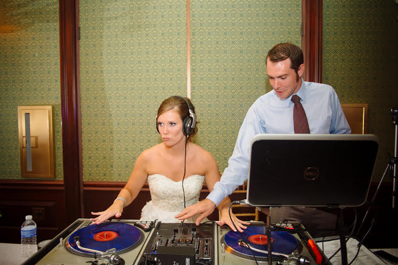 Ridiculous Entertainment on the job. Scratching records with the bride.Photo Credit: Marcella Treybig Photography