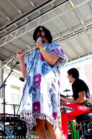 Photography by JUMPPhilly.com.  Man man sporting Naomi's tunic live in concert.