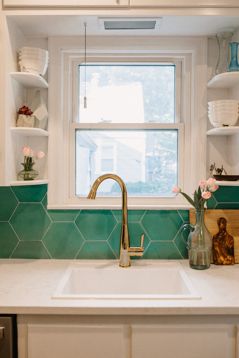 "This kitchen is a perfect example of when 'tile makes the space.' The rest of the kitchen stayed humble but this is the one feature we spent a little extra on. These are  8"" Hex in Kelly ."