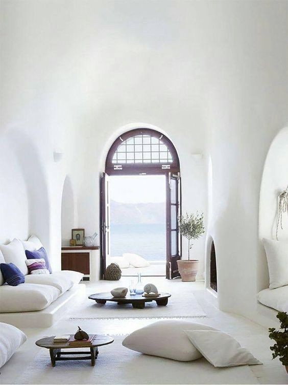 Ok we all probably don't have arched doorways heading out to the ocean, but if you take all that away and just look at the stuff you can see that it isn't minimal but its curated and what is there has purpose. Image via Pinterest