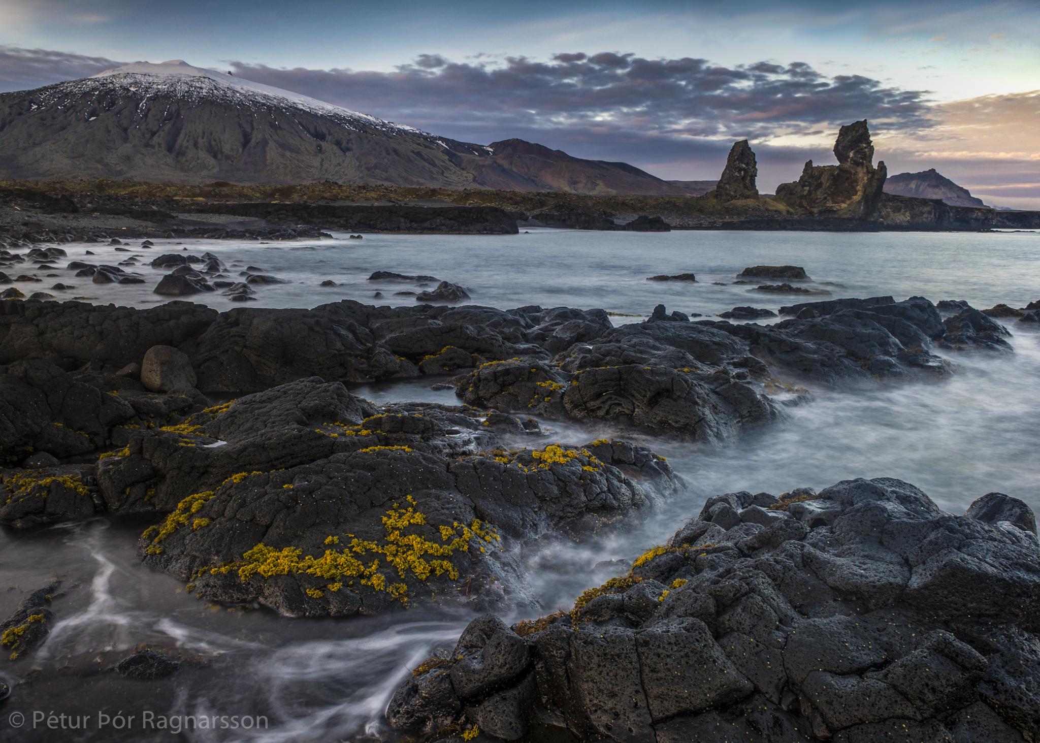 Lóndrangar seastacks with Snæfellsjökull glacier in the background