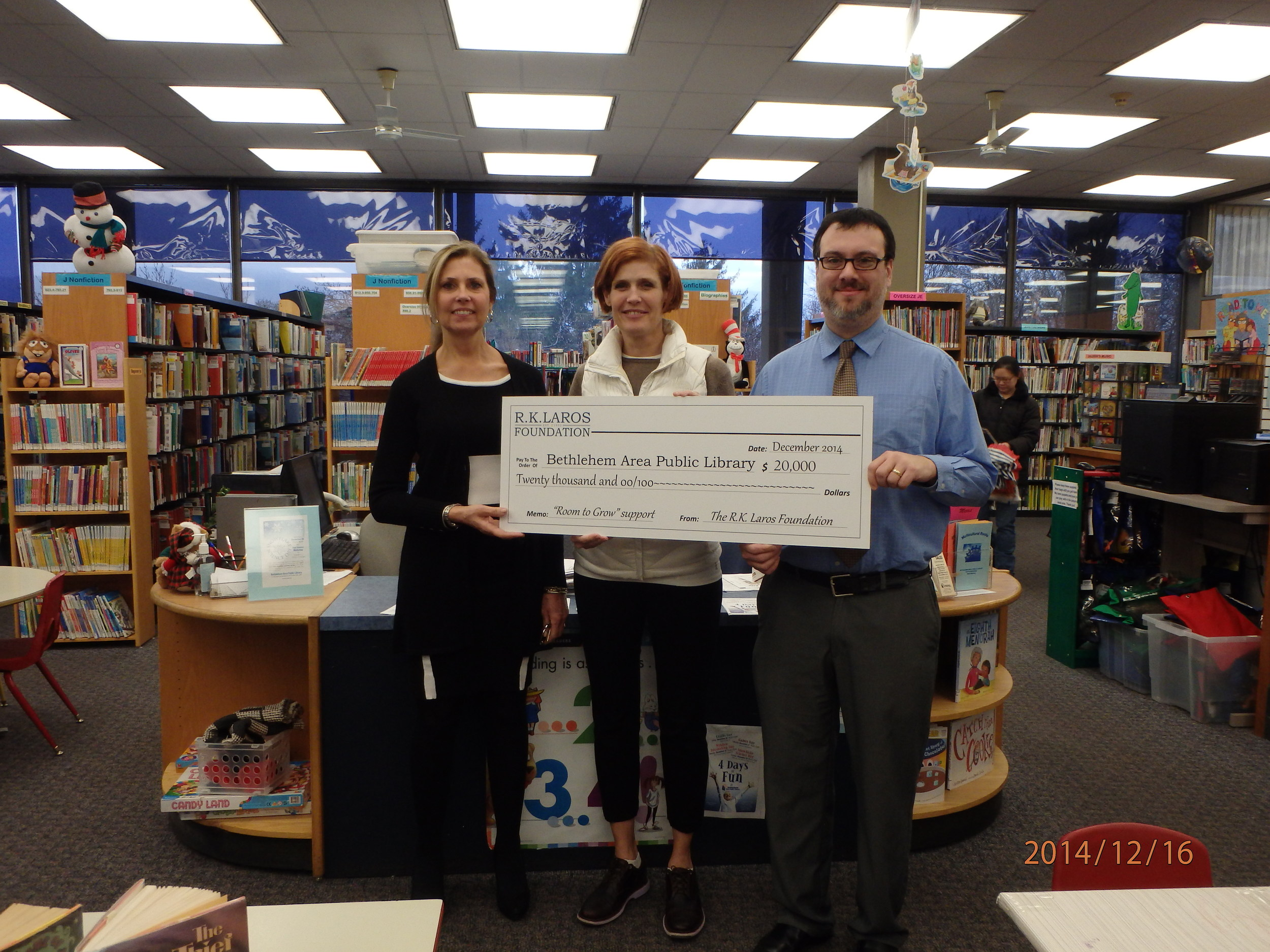 """R.K. Laros Trustee Laura Bennett Shelton awards the Bethlehem Public Library Grant to Executive DirectorJosh Berk and Development Director Liza Holzinger supporting the """"Room to Grow"""" campaign."""