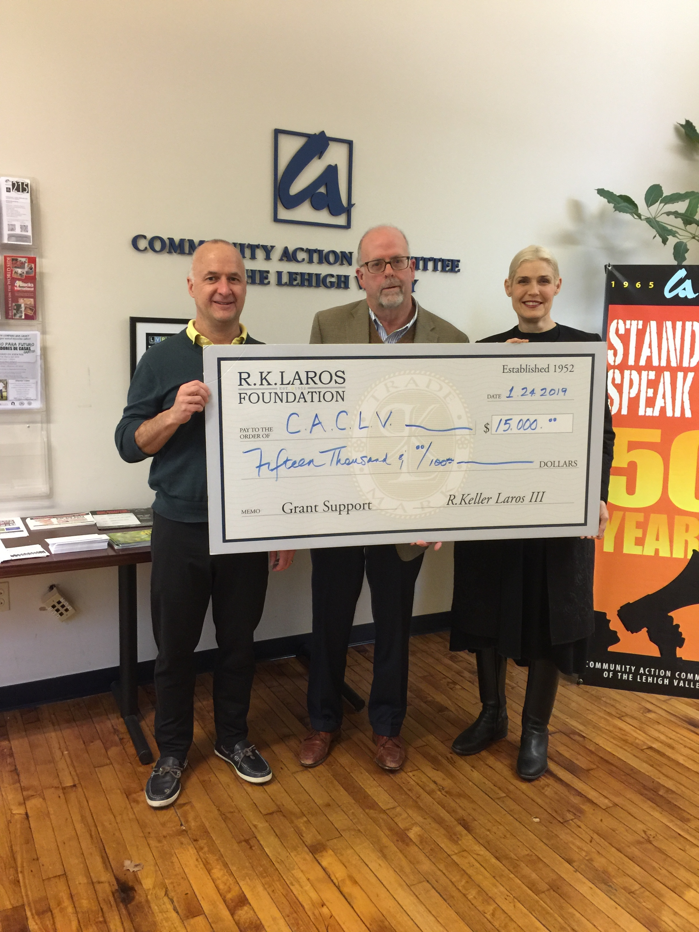 Trustee George Mowrer and Vice Chair Laura Bennett Shelton on 1.24.19 present the grant to CACLV Executive Director Alan Jennings to support outside repairs to the Forte Building.