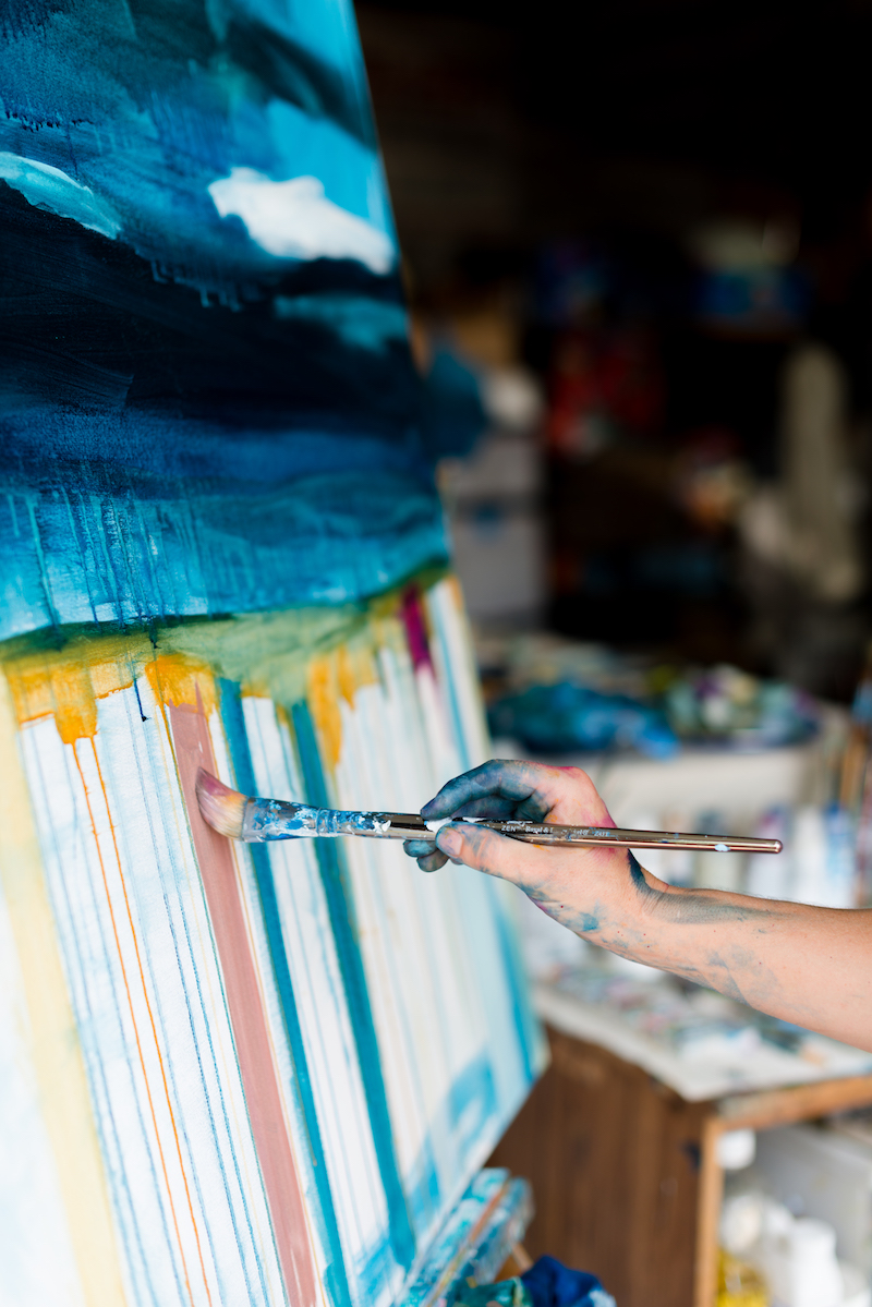 At work on the easel; photo by Kirsten Smith Photography