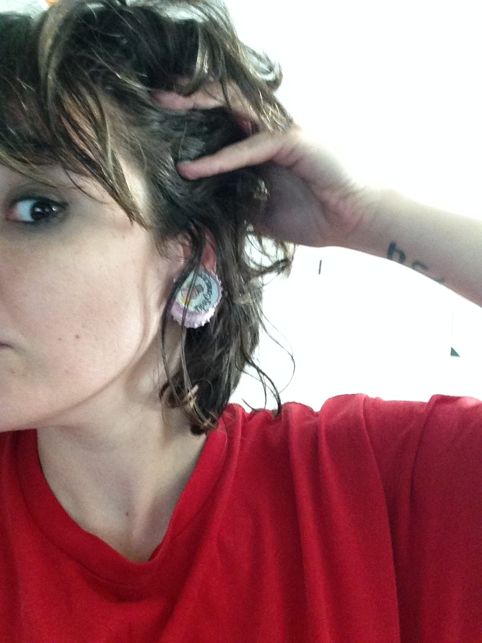 Bringing that button earring look back, baby. Seriously though, strong magnets, right?