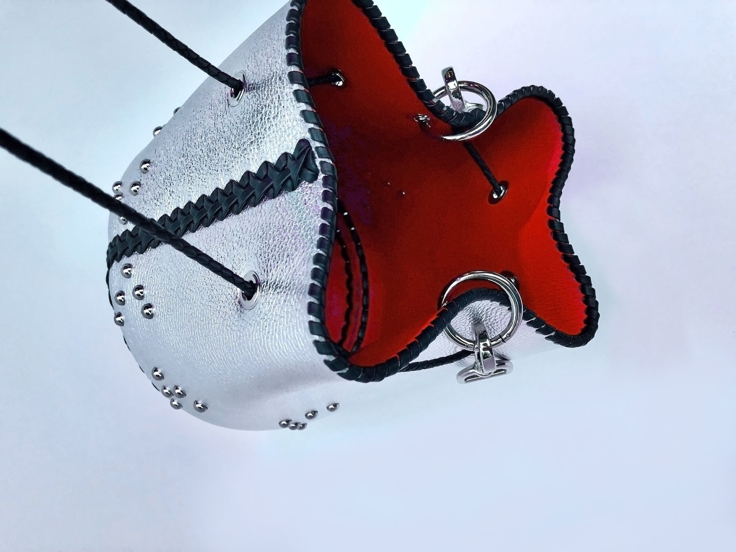 Silver handbag lined in vampire red leather