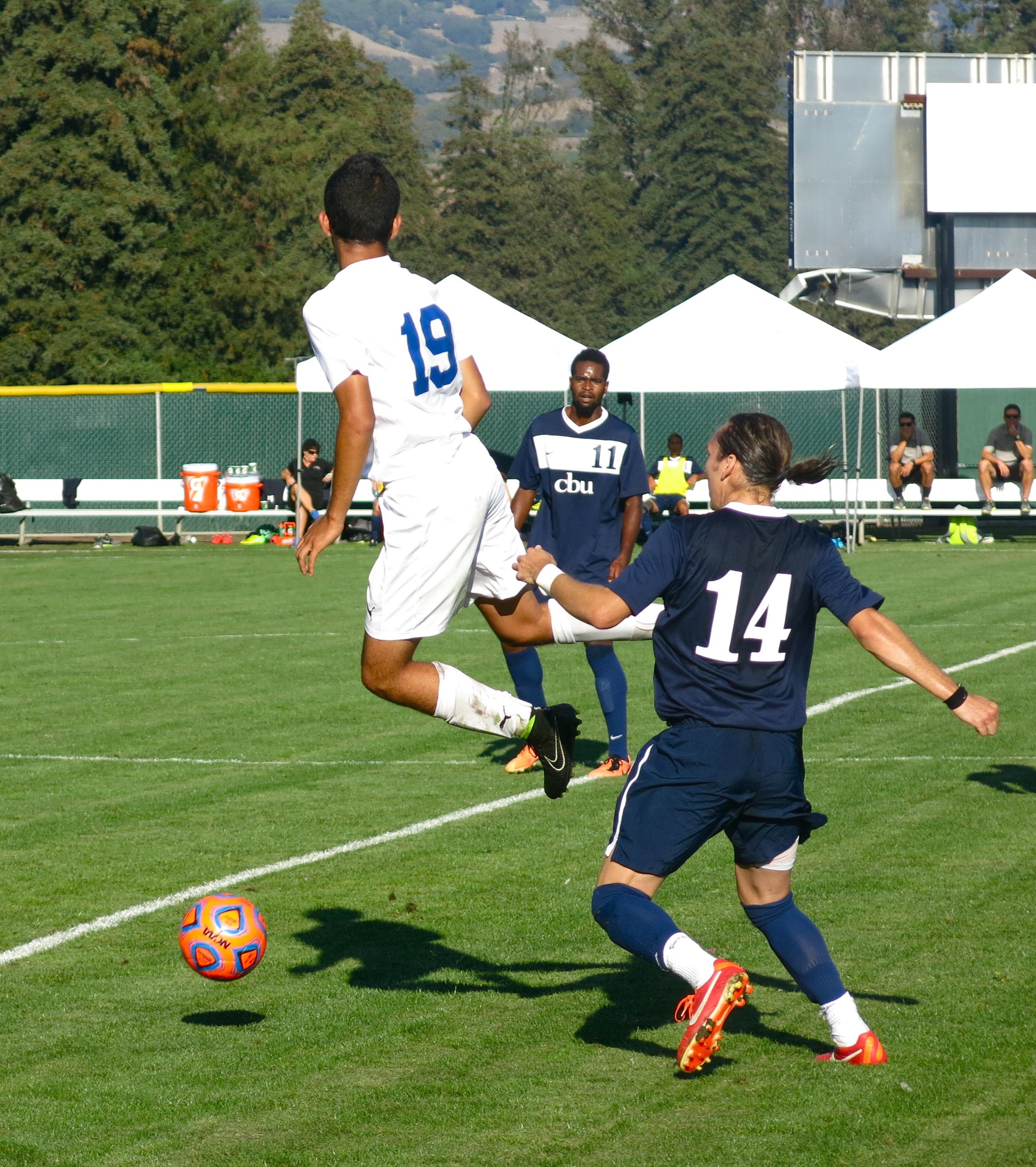 STAR // Maud Busson   Freshman Armando Coronel gains possession of the ball.