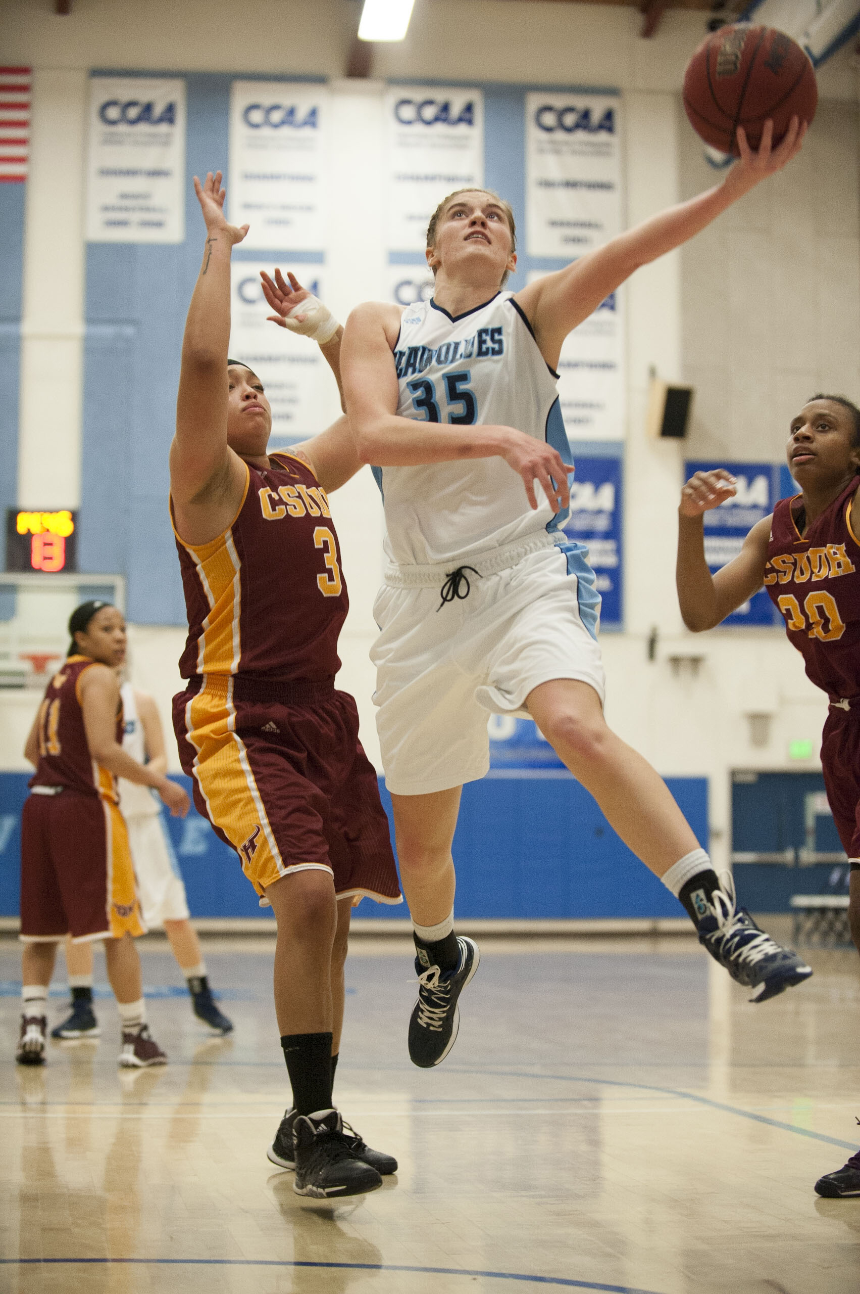 STAR // Connor Gibson   Molly Kommer goes in for a layup.