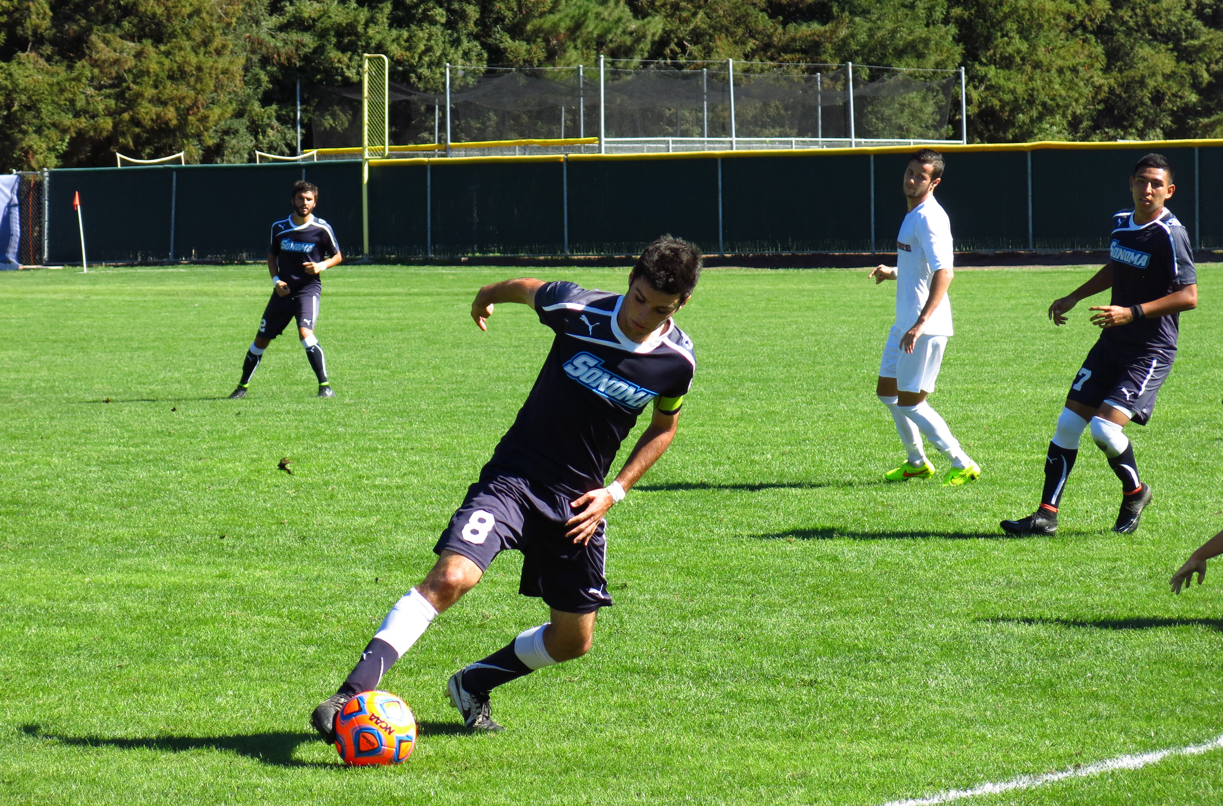 STAR // Maud Busson   Junior Sean Callahan works the ball up to the goal.
