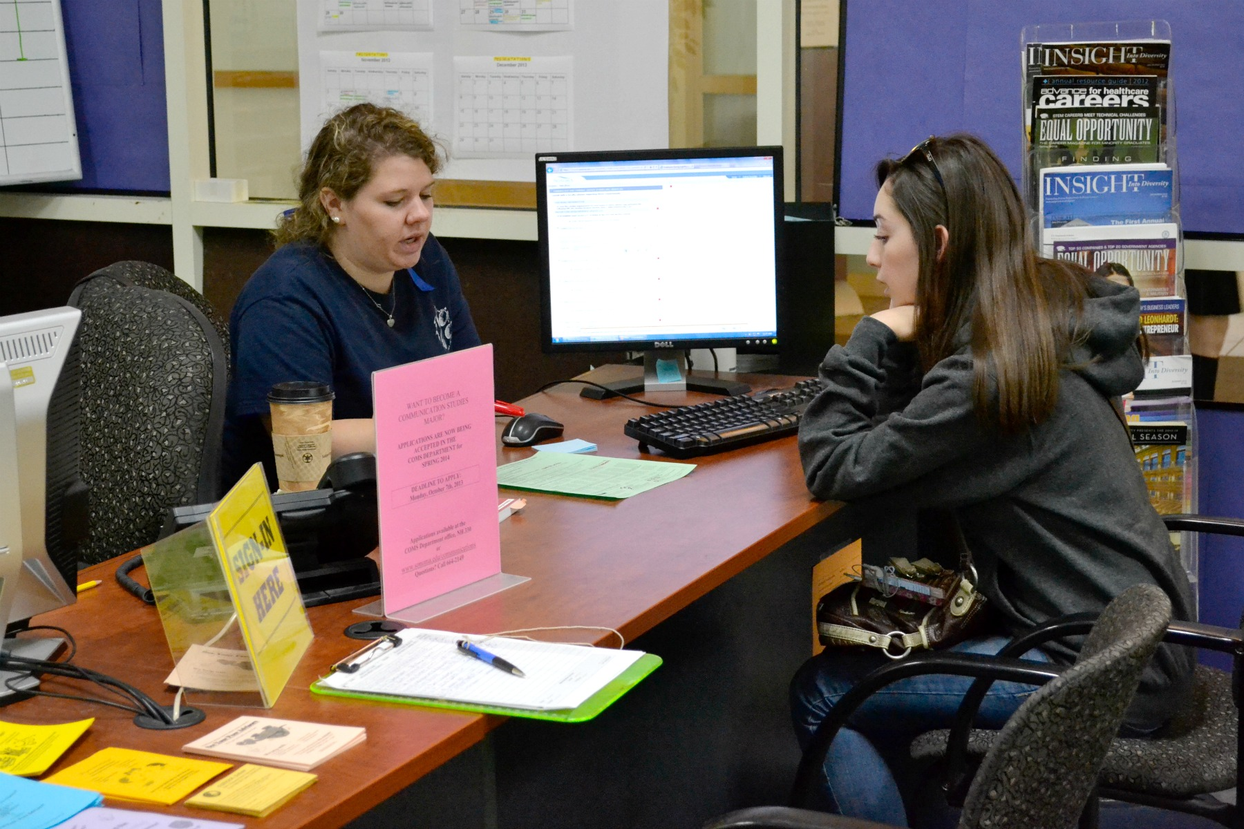 STAR // Lina Raffaelli    Peer advisor Lauren Dillier helps students figure out which requirements they need to complete and the best way to do it.