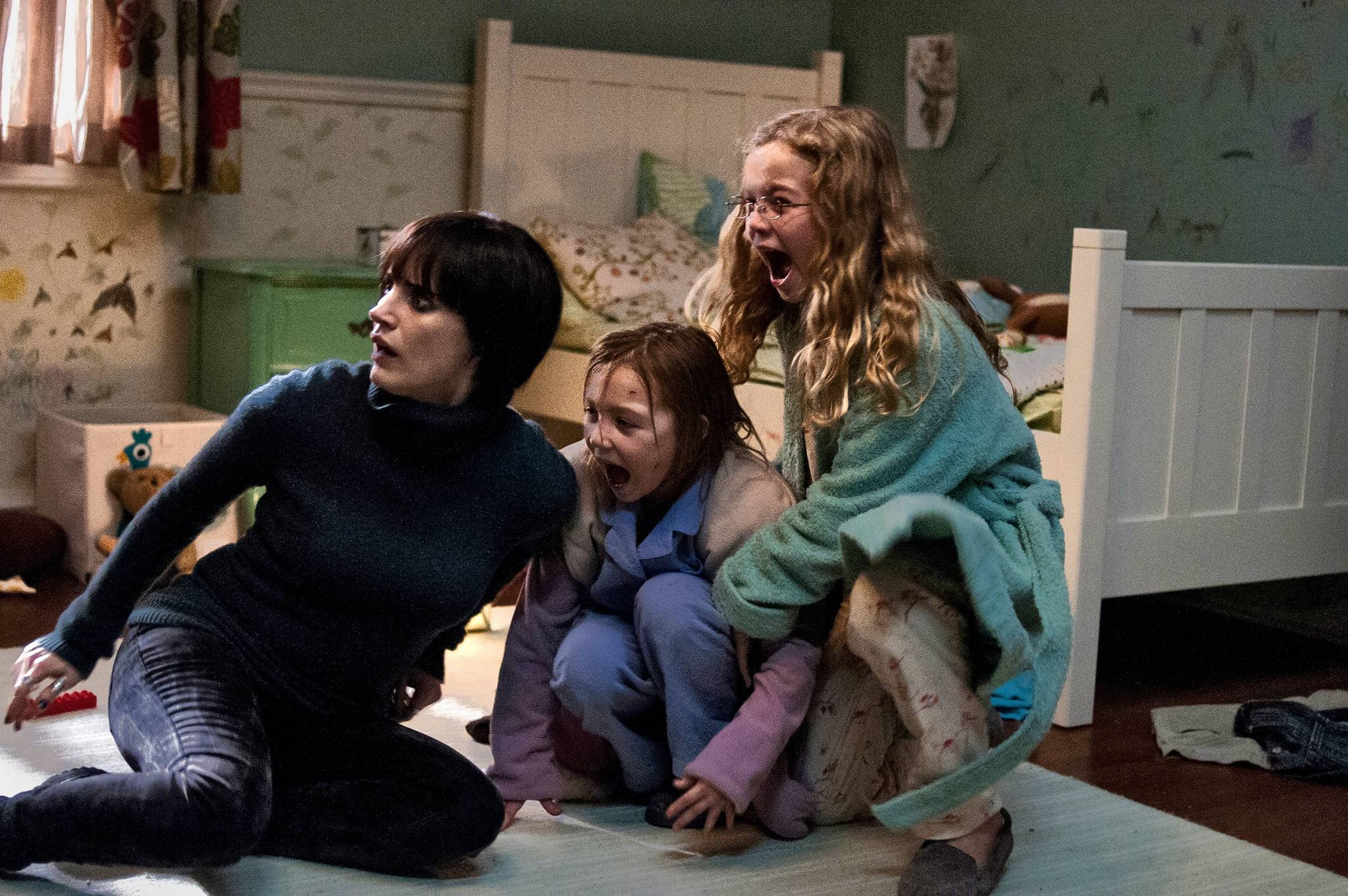 """moviereelizations.com    """"Mama"""" follows the chilling story of two little girls, lost in the woods for five years, whom only survived thanks to a creepy, twisted entity known to the girls as """"Mama."""" When the girls are recovered and sent to their uncle to live, the ghost follows with them, determined not to lose her """"children""""by any cost--even if that means destroyingtheir new parents."""