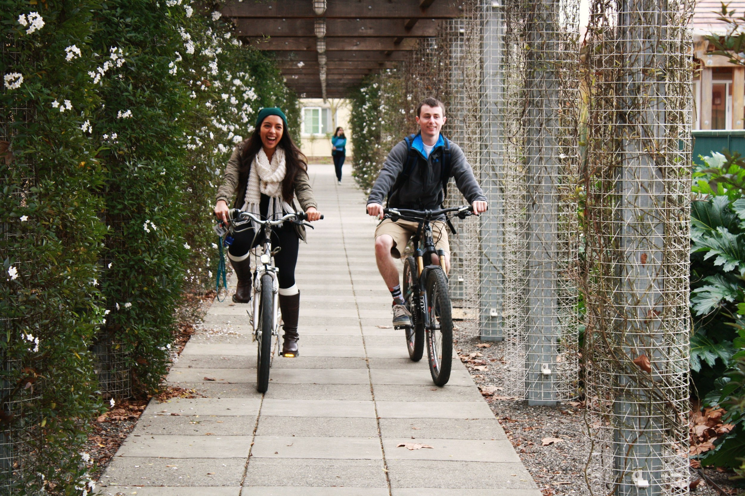 STAR // Niquie Wilson   Breanna Pereira, 19, rides her bike home with her friend Josh Krisman, 20 on Thursday.