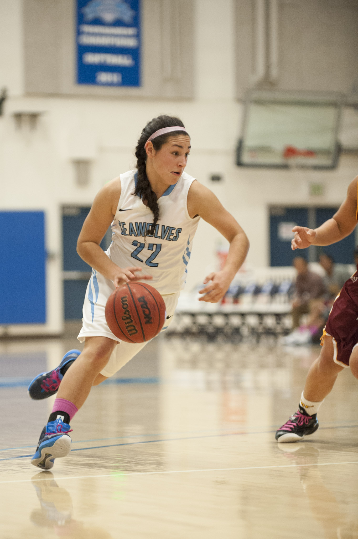 STAR // Connor Gibson   Freshman guard Jessica Mitz drives to the hoop.