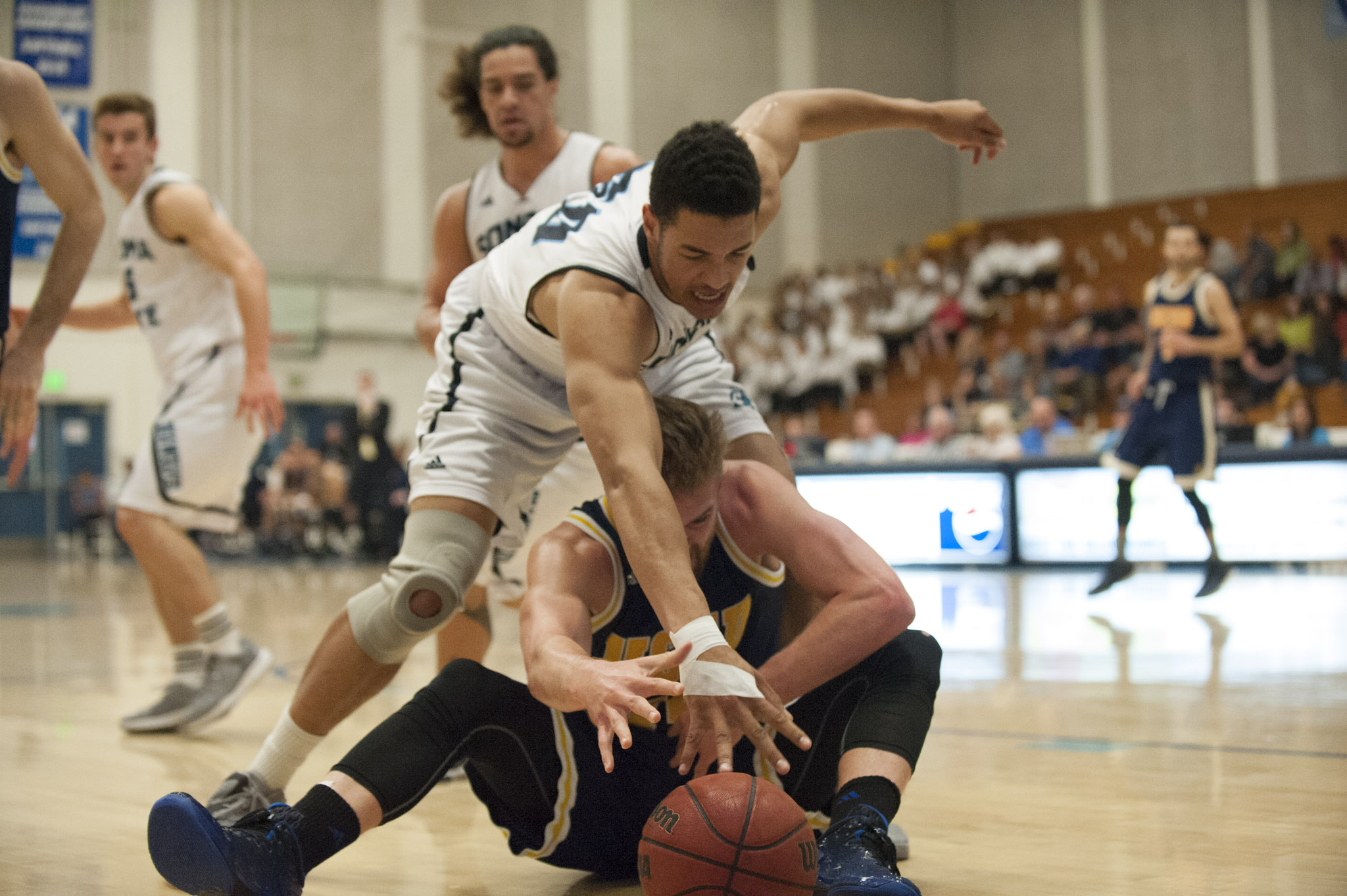 STAR // Connor Gibson   Junior Andy Mitchell and sophomore Nathan Molony-Benjamin battle for a rebound.