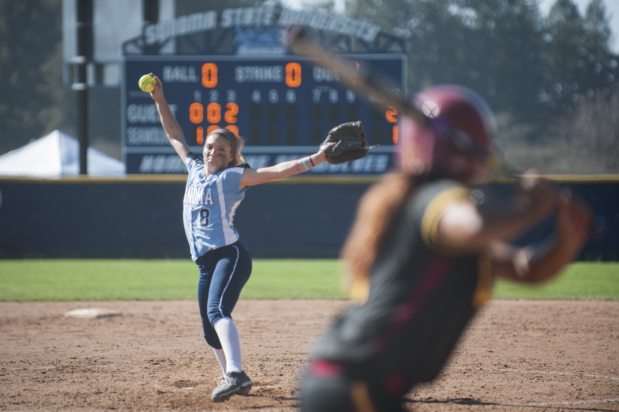 STAR // Connor Gibson   Junior pitcher Amanda Llerena finishes her motion versus CSU Dominguez Hills.Senior outfielder Keeley Ray makes gets a piece of the ball in her at bat.