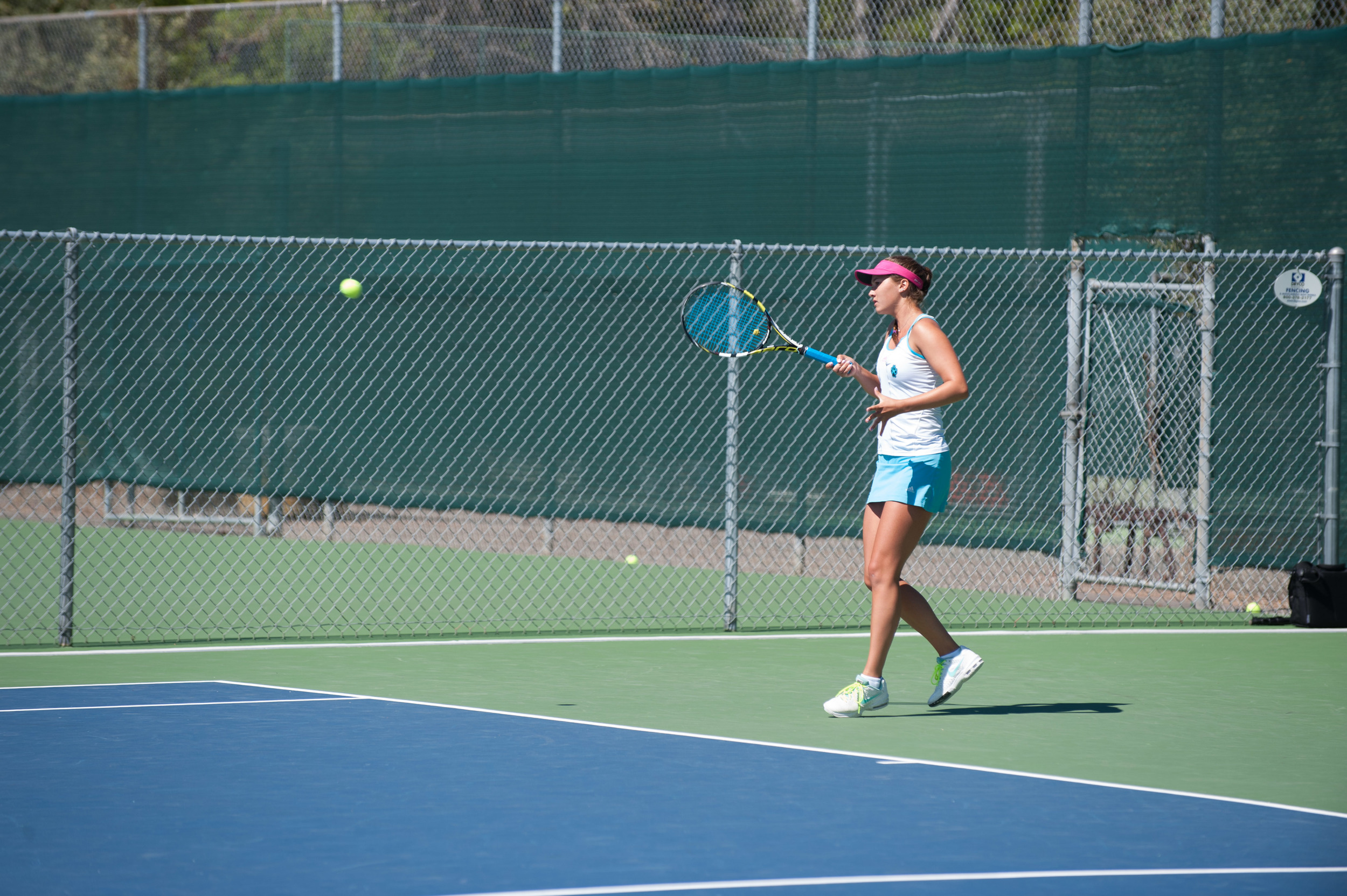 STAR // Connor Gibson   Sophomore Karlee Budge, who won both her matchups, returns a shot.