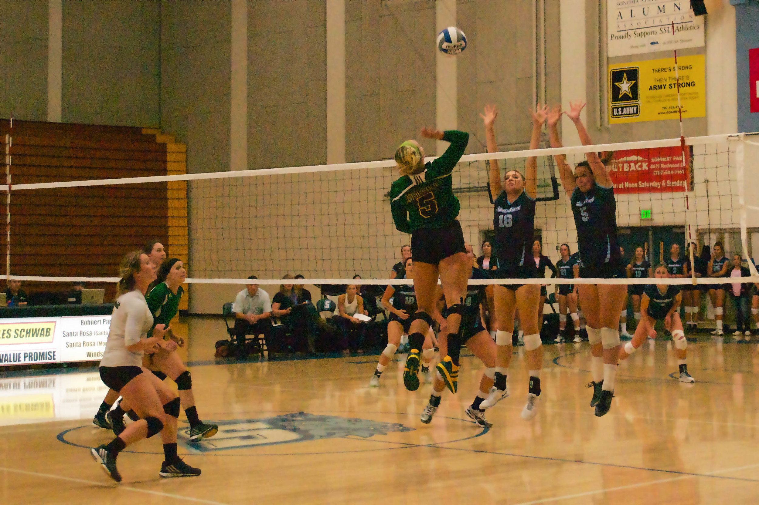 STAR// Nicole Detmers   Senior Caylie Seitz and junior Rachel Andrews go for the block against visiting HSU.