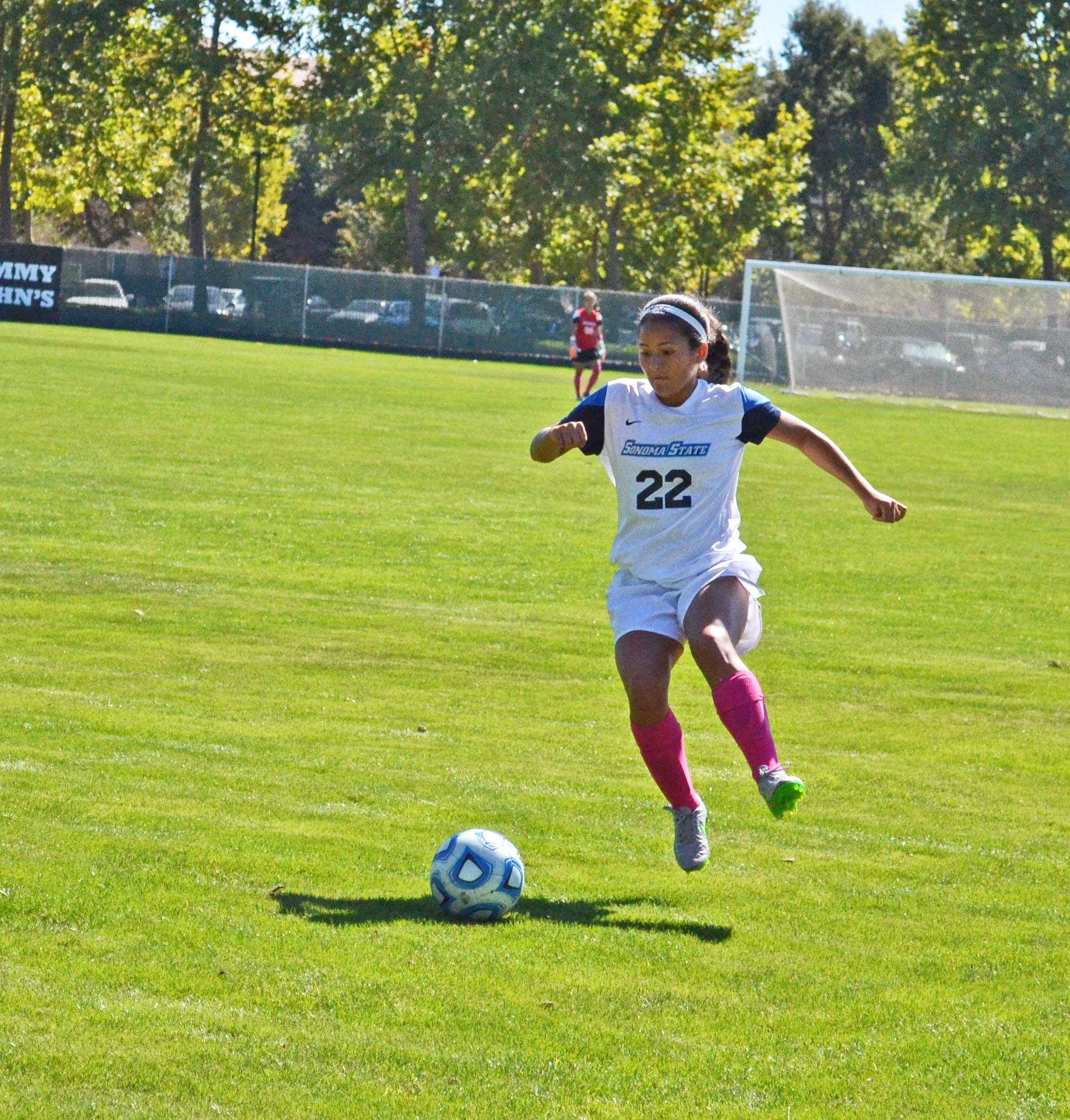 STAR// Nicole Detmers   Sophomore Courtney Shoda advances down the field against UC Santa Cruz.