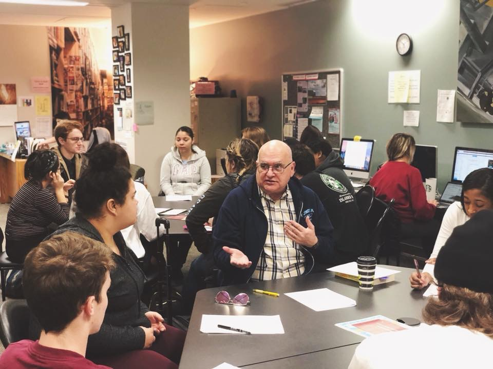 A Writing Center tutor helps students answer homework questions. Courtesy // Alix Parkhurst