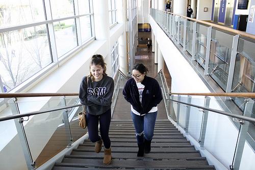 Students Doreen Marandon and Marsala Enloe make their way upstairs to the bookstore.