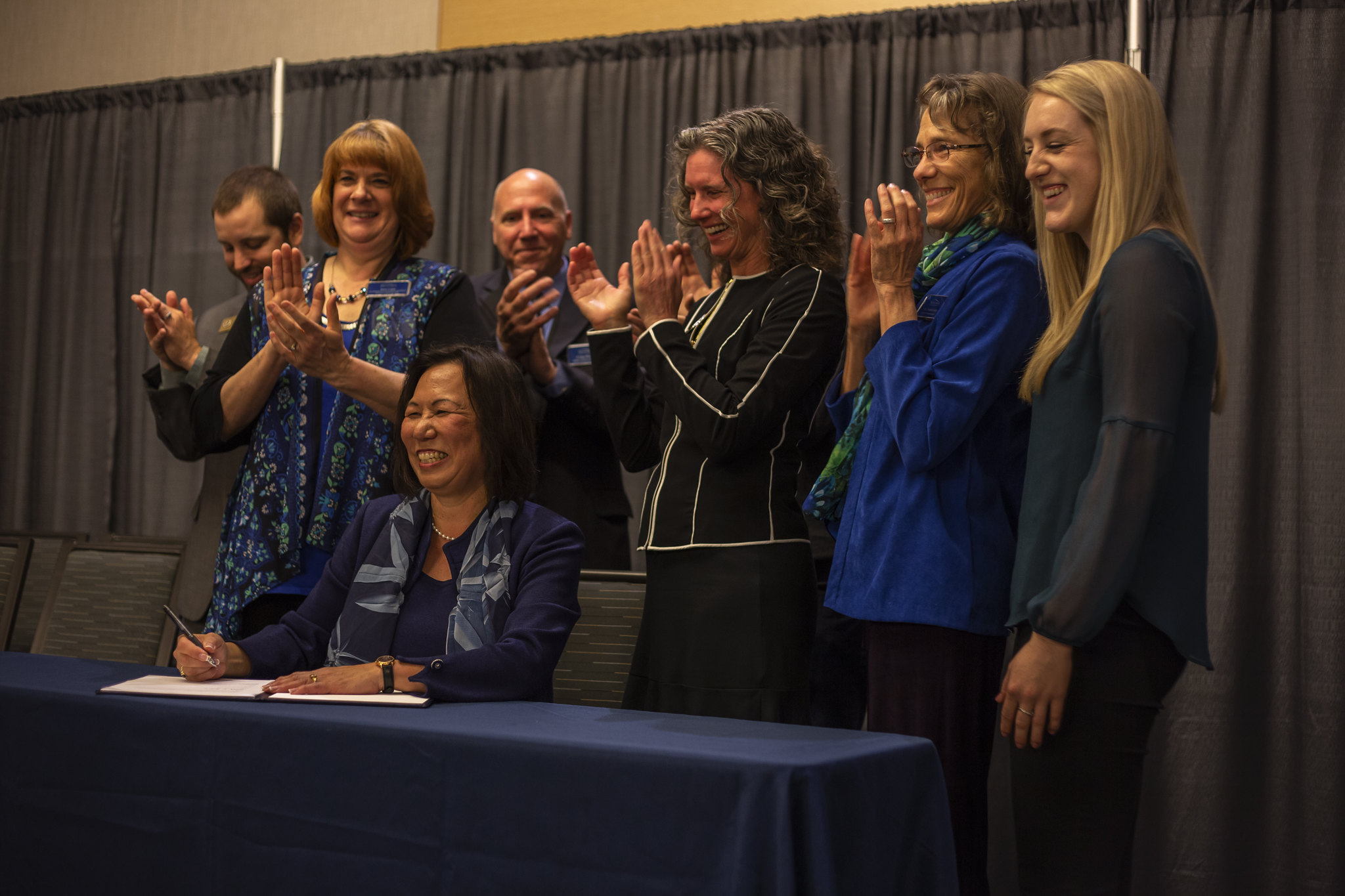 President Judy Sakaki, seen above signing the Climate Pact, spoke at length about climate change its impact on all of us during a ceremony on Friday, April 5.