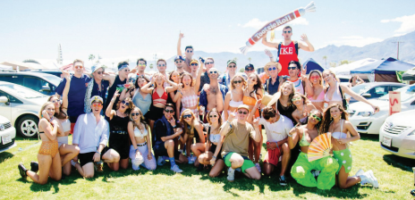 STAR // Gabriella Novello   Sonoma State students, alumni and their inflatable tootsie roll named Teresa pose for a group picture at the first weekend of Coachella on April 12 in Indio, California.