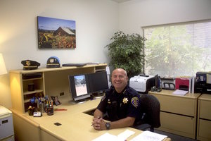 STAR// Analy Bravo   University Chief of Police smiles at his desk last semester.