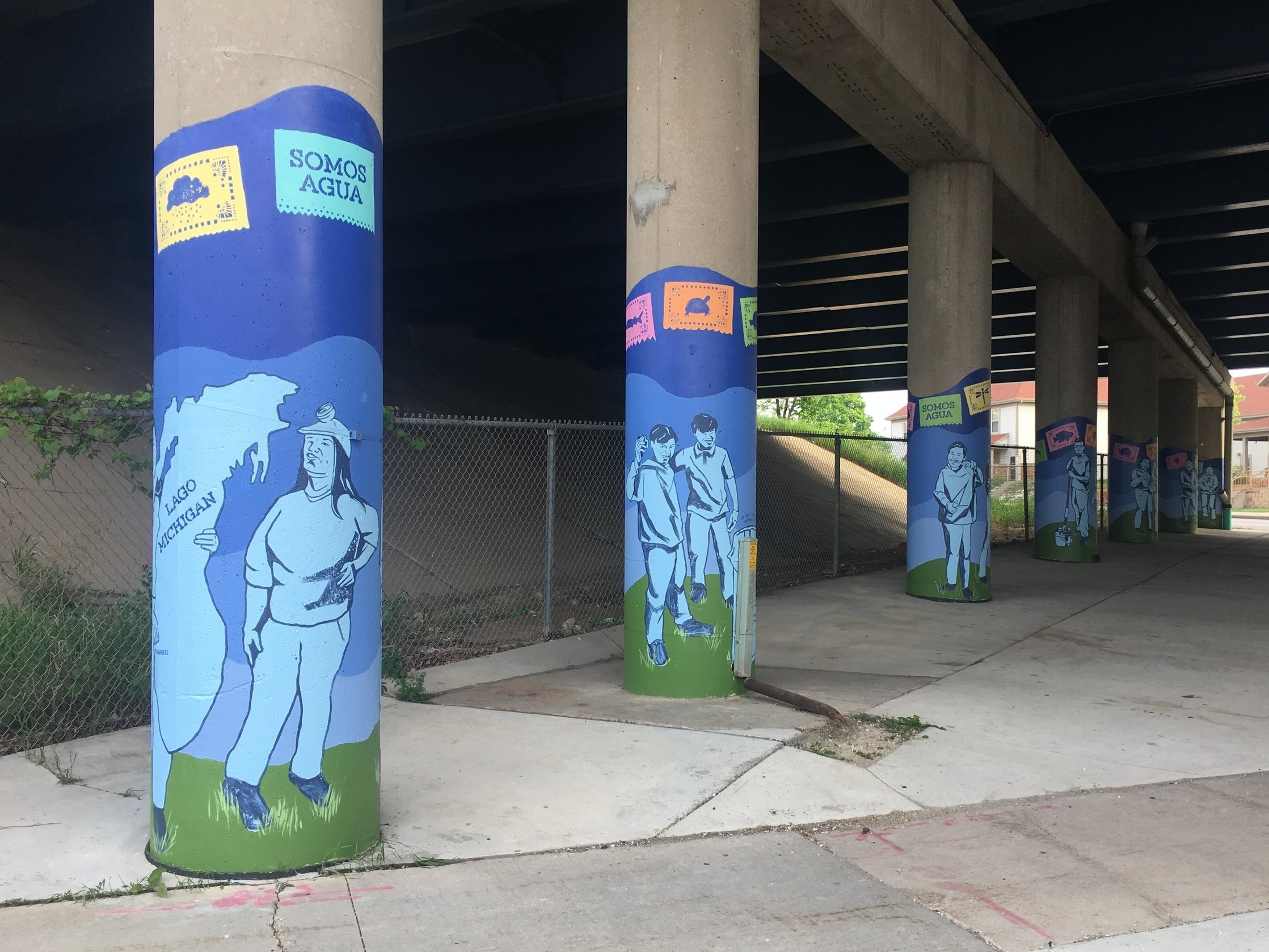 Melanie Ariens' 9 pillar mural beneath the expressway by UCC ACOSTA Middle School