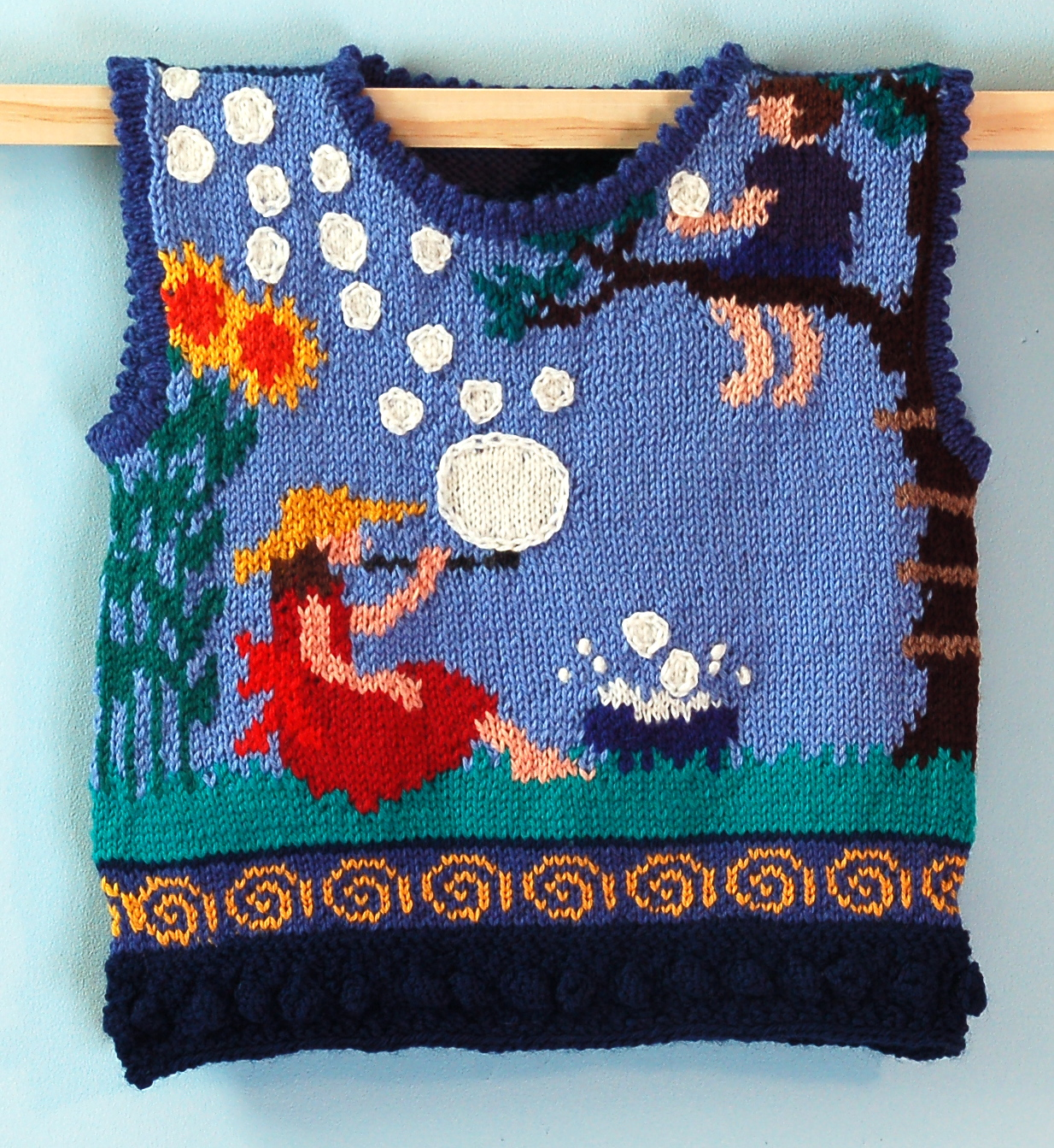 TWO YEARS: BUBBLES FRONT    Here is a scene of summer. The bubbles are huge! The bubbles float from the front to the back. The hem trim is golden swirls on periwinkle. The neck and armhole openings trim is periwinkle picot trim. The hem is bobbles in dark blue.