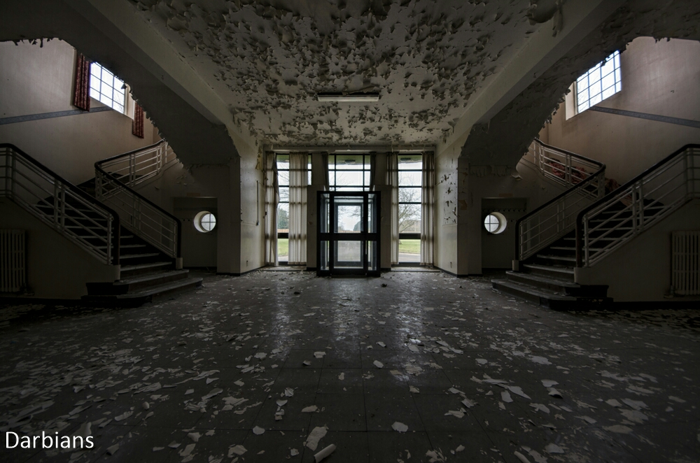 Severe peel from the ceiling at this Decaying RAF base. I love how its coated the floor too.