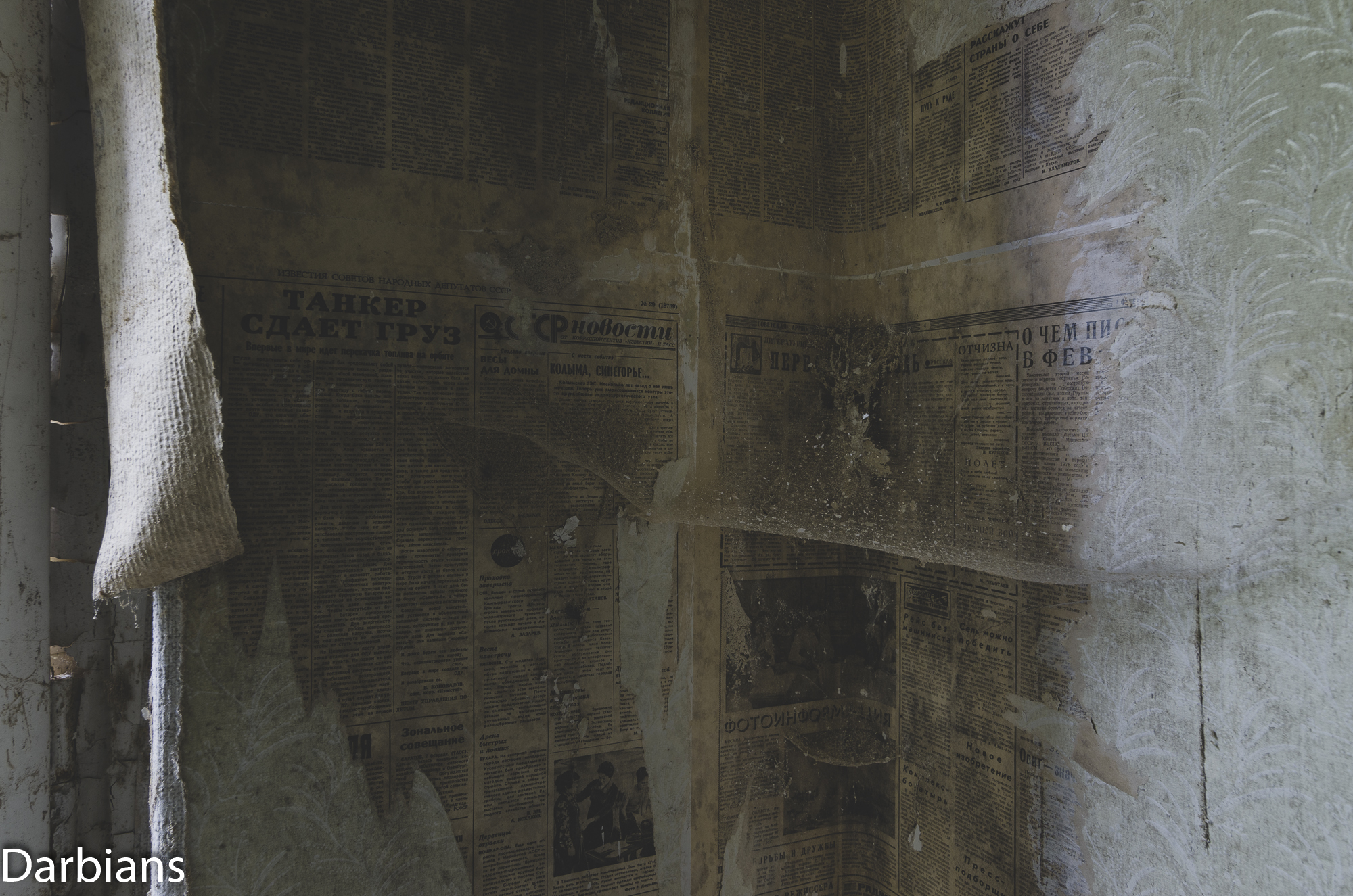 Details of newspapers used as wallpaper.
