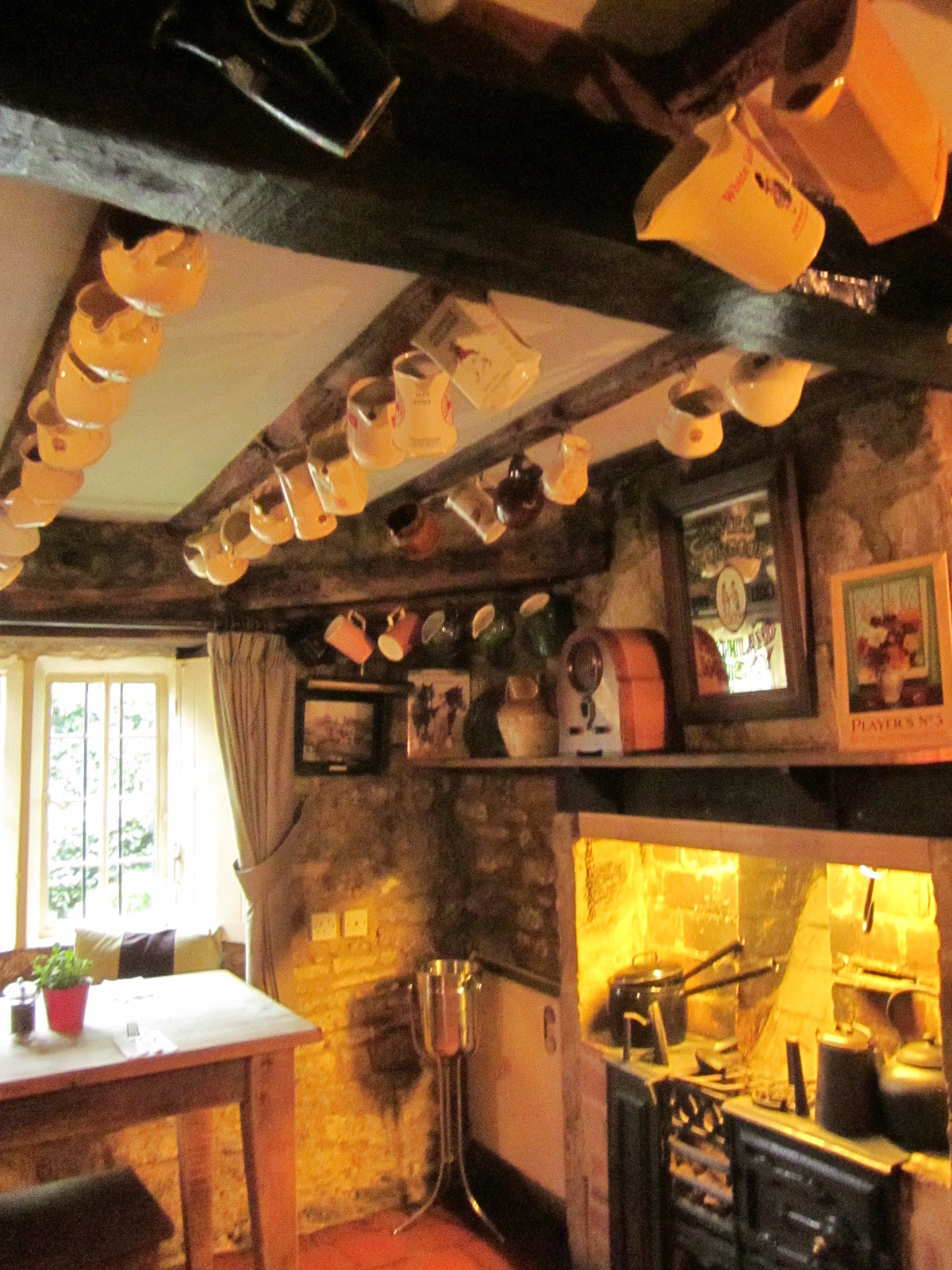 Personal mugs on the ceiling of the Falkland Arms pub. (A matter of hygiene at one time...?)