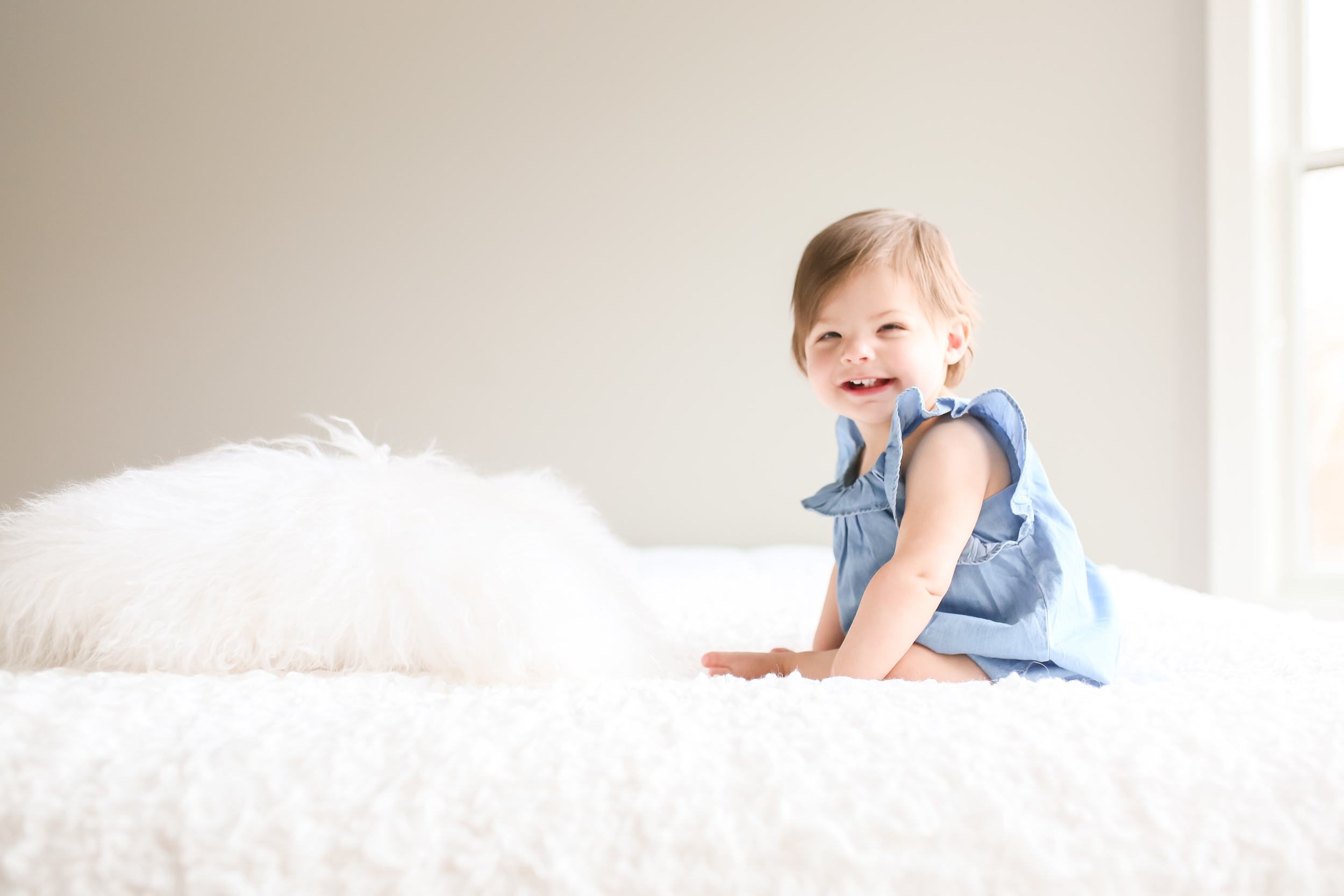 one year old baby girl on bed