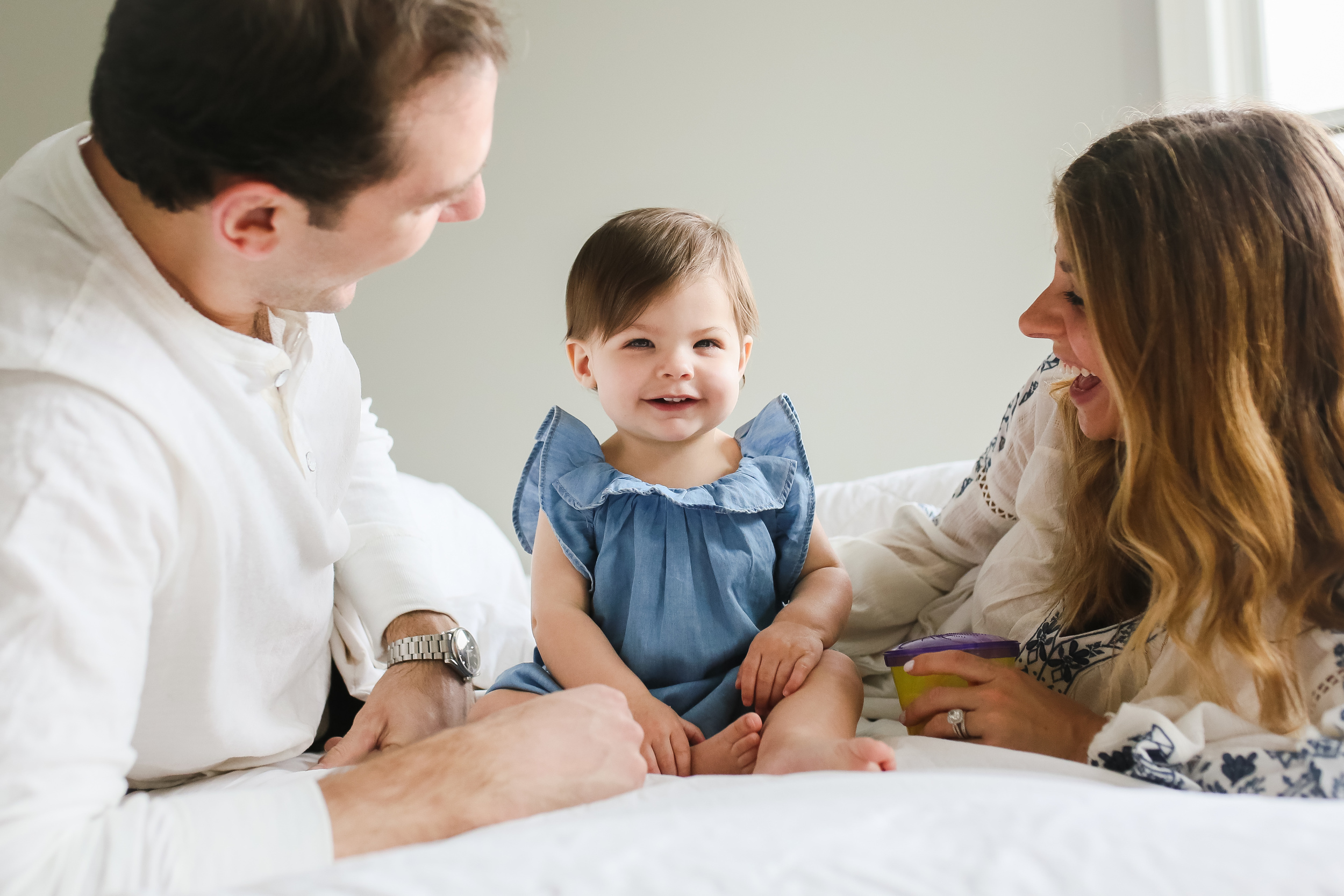 family with daughter on bed