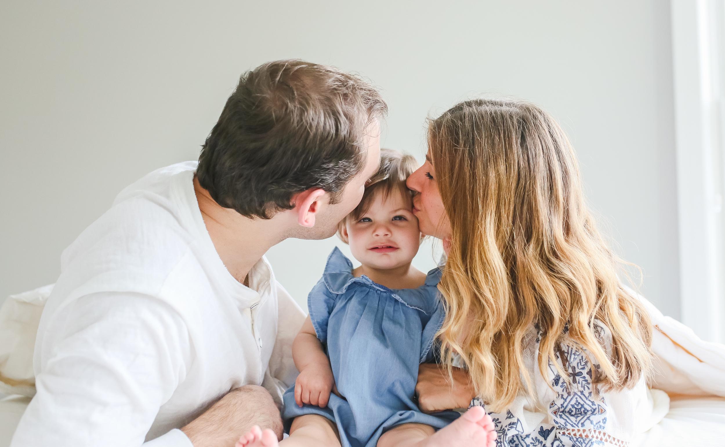 family baby kiss