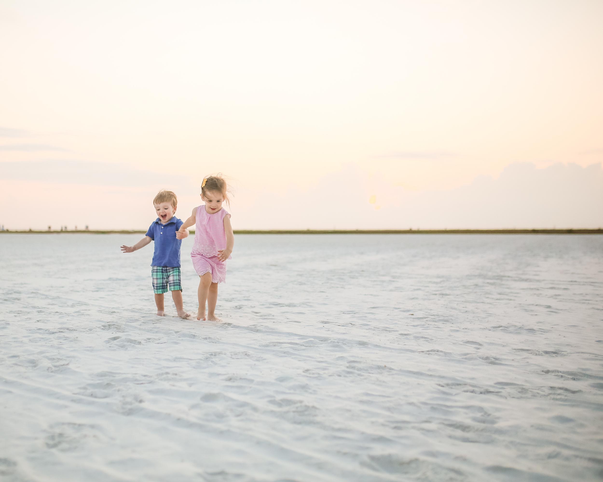 little friends running on beach