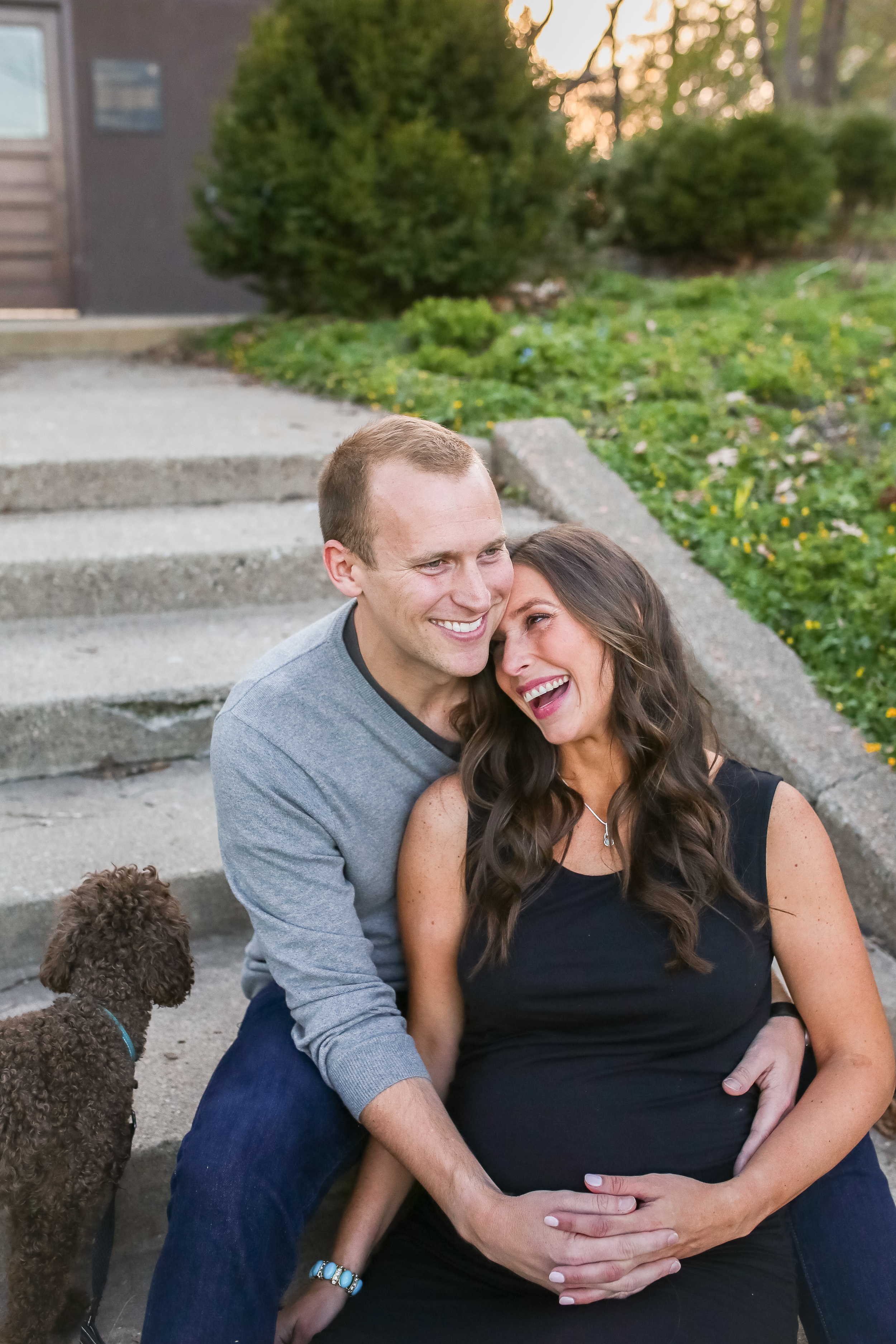 maternity couple laughing